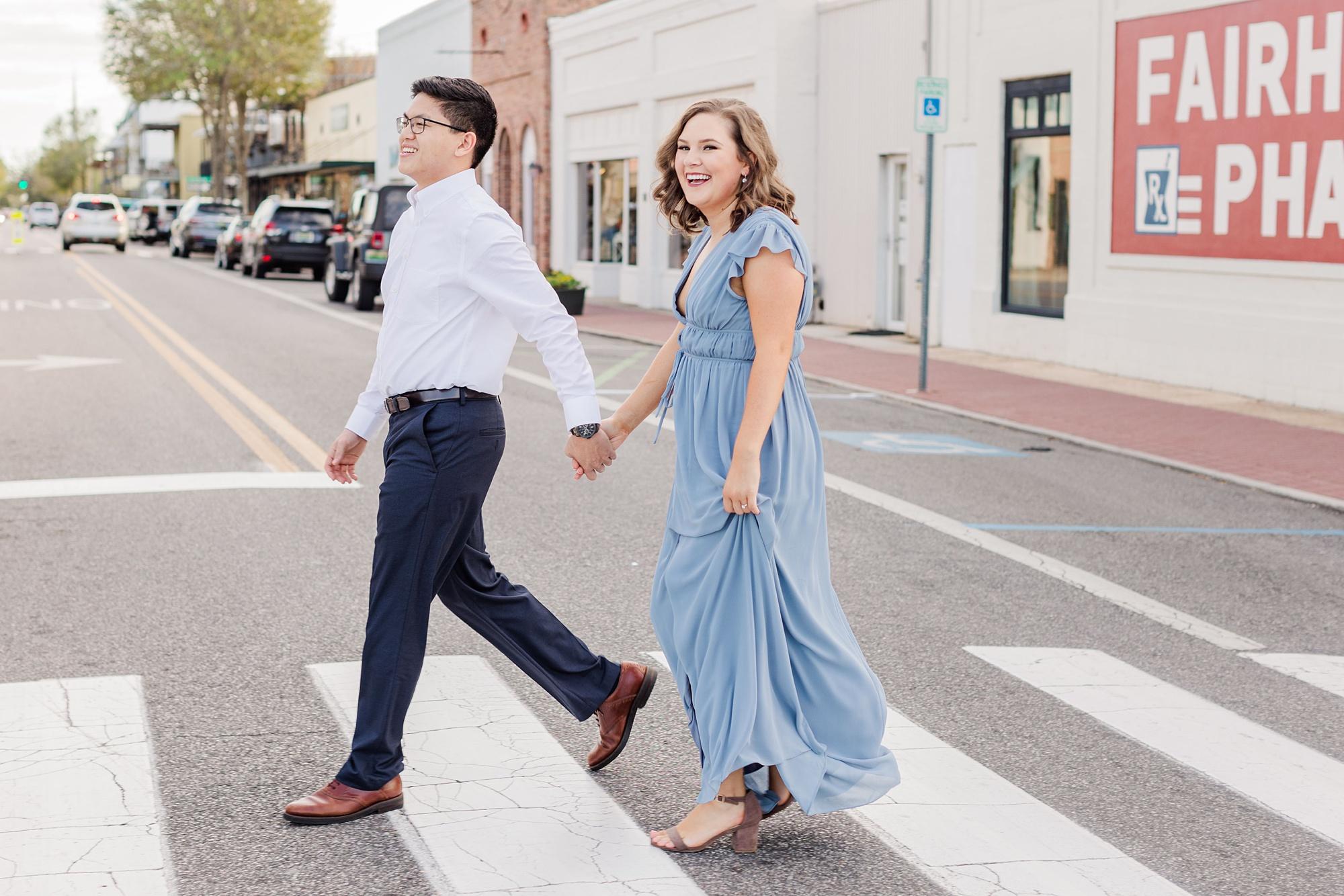 bride and groom walk across crosswalk