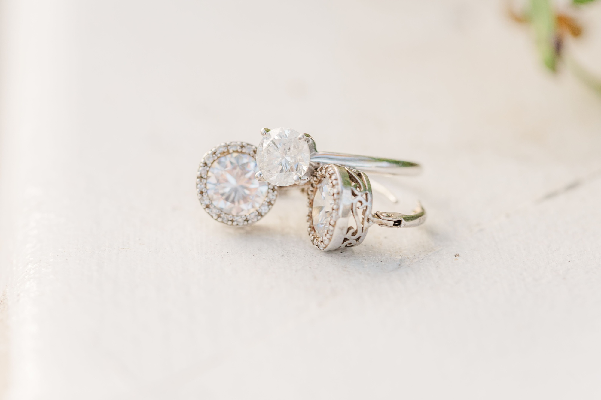 engagement ring rests on earrings