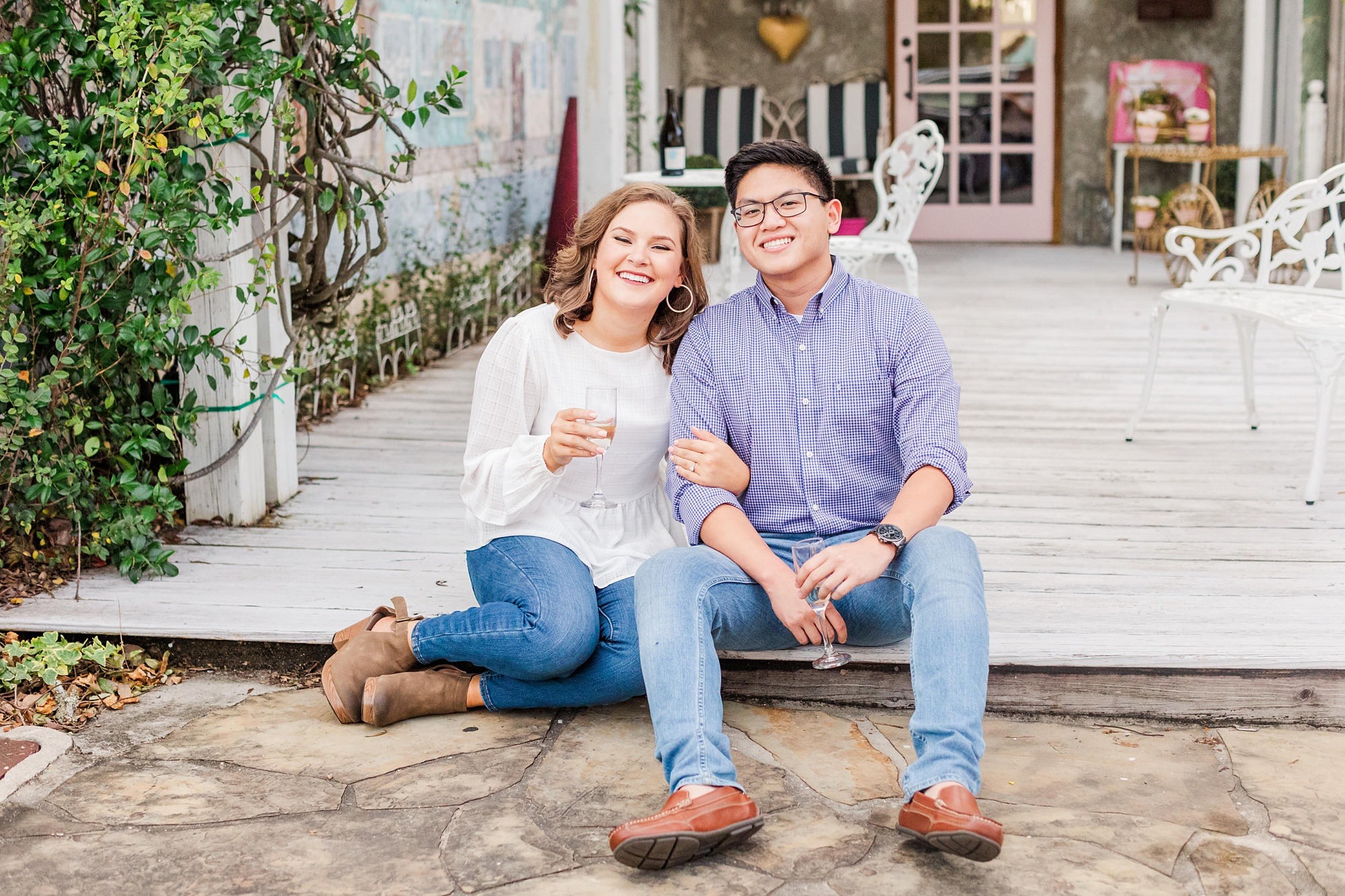 Downtown Fairhope engagement photos of bride and groom with champagne