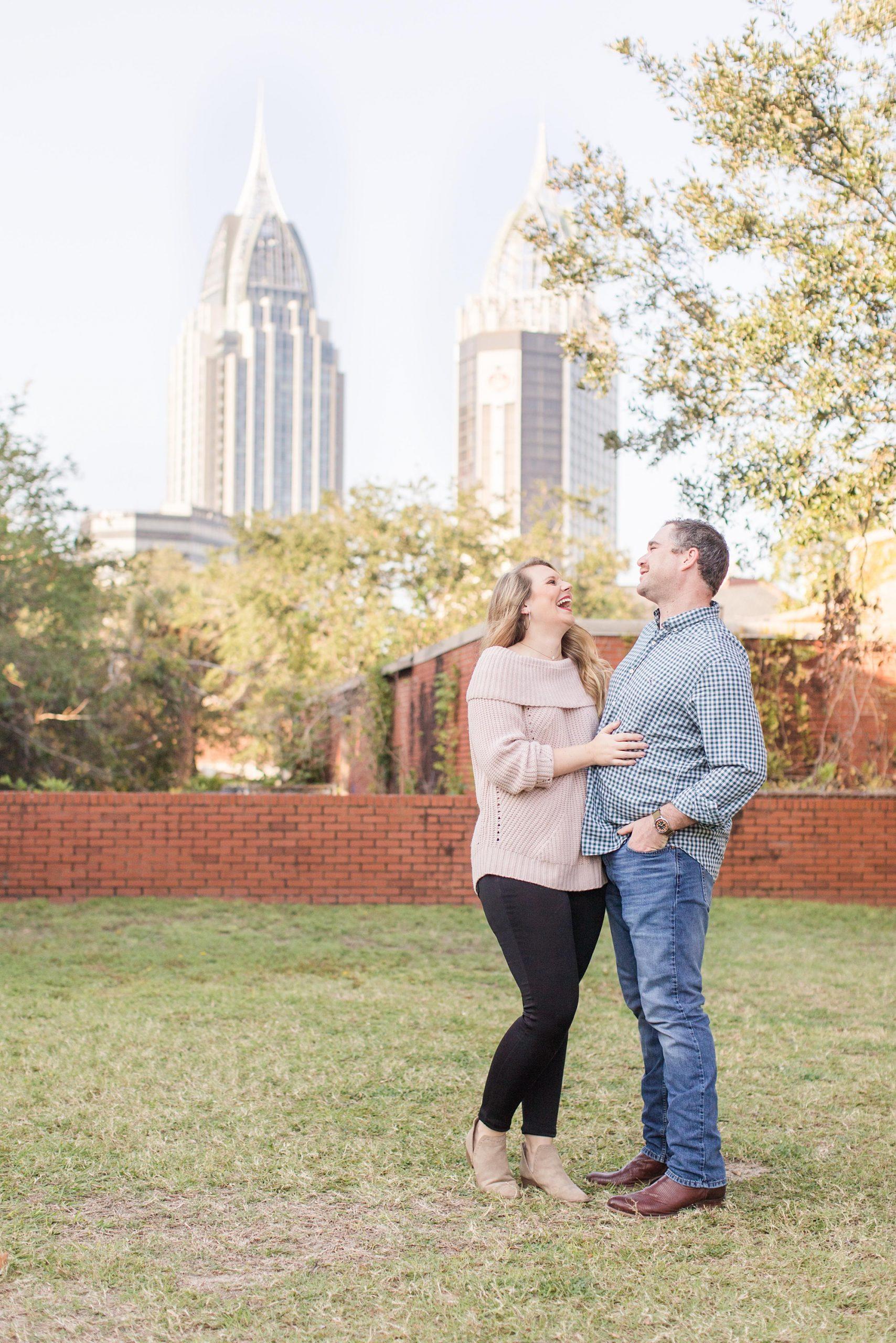 couple laughs during Mobile AL engagement portraits