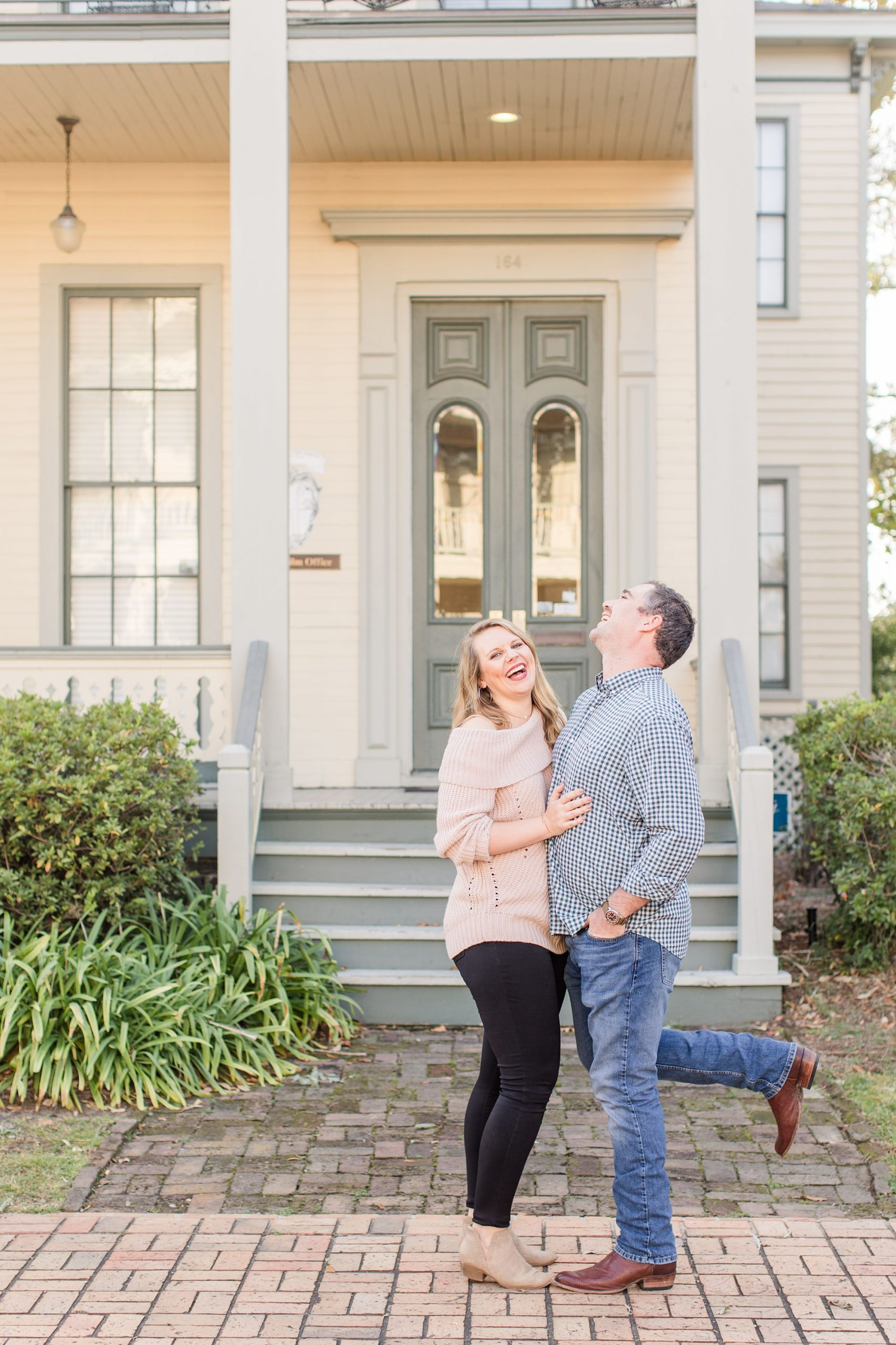 engaged couple laughs during Fort Conde Inn engagement photos