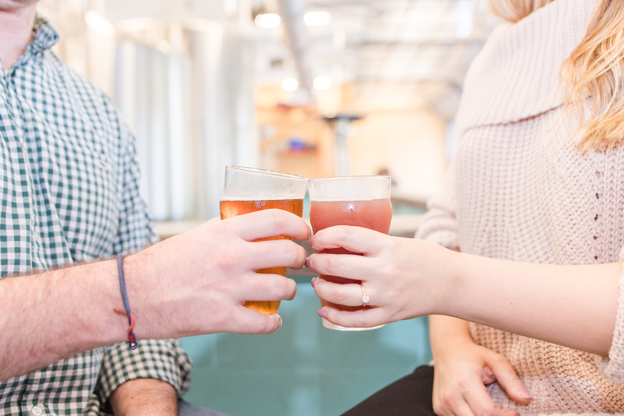 bride and groom toast beers during Serda Brewing engagement photos
