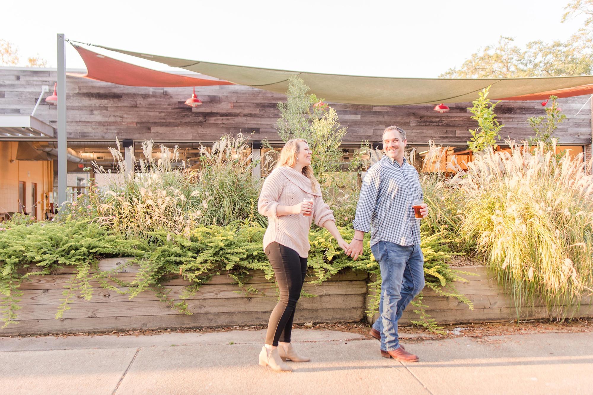 couple walks along patio at Serda Brewing