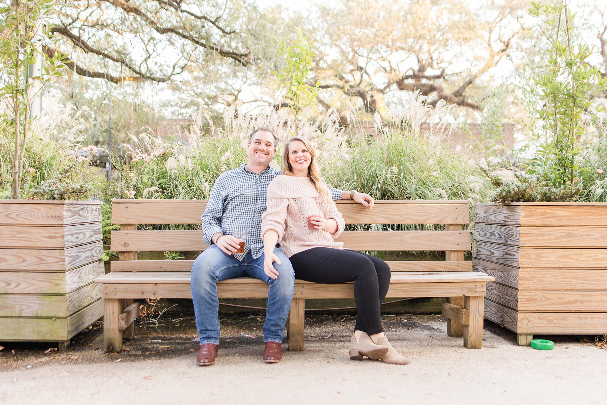 engaged couple sits on bench at Serda Brewing