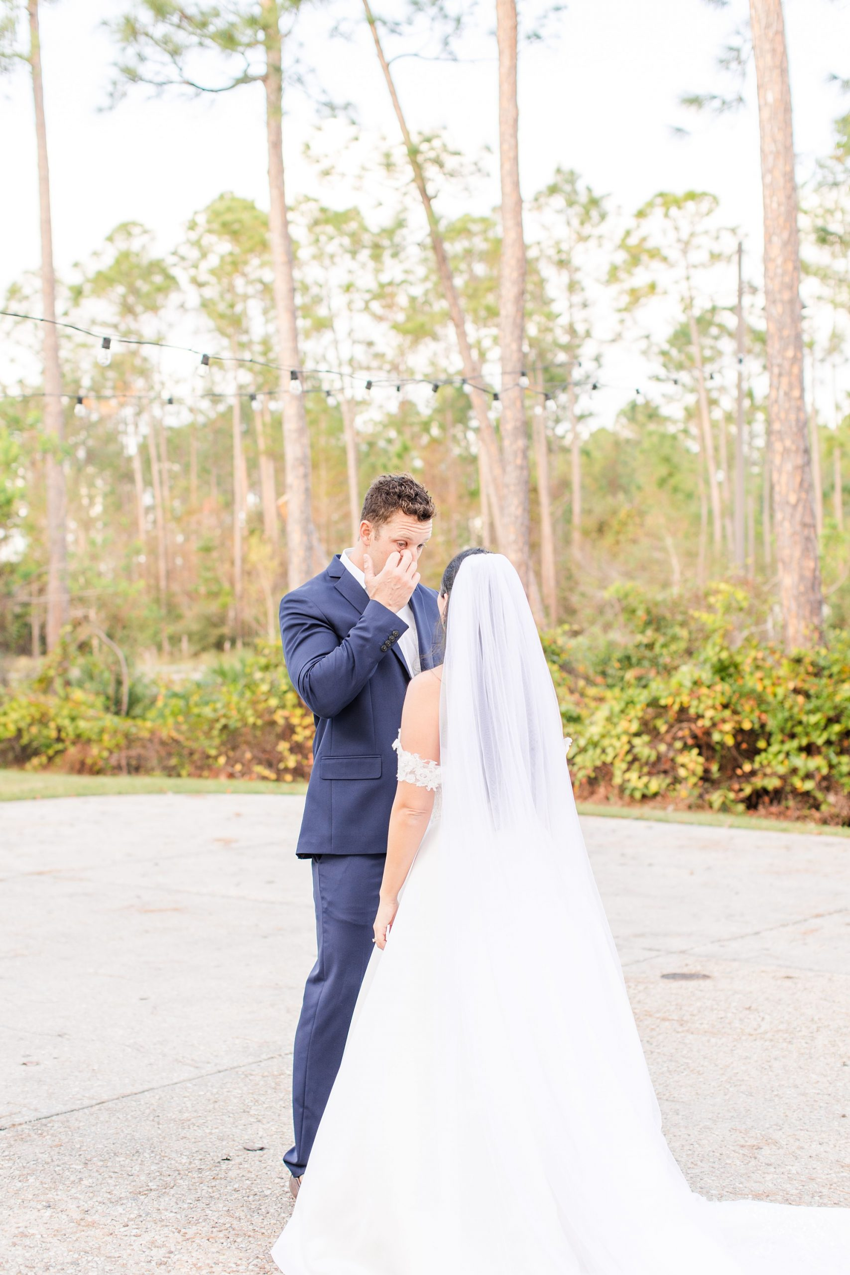 groom cries during first look at Heron Pointe at the Wharf