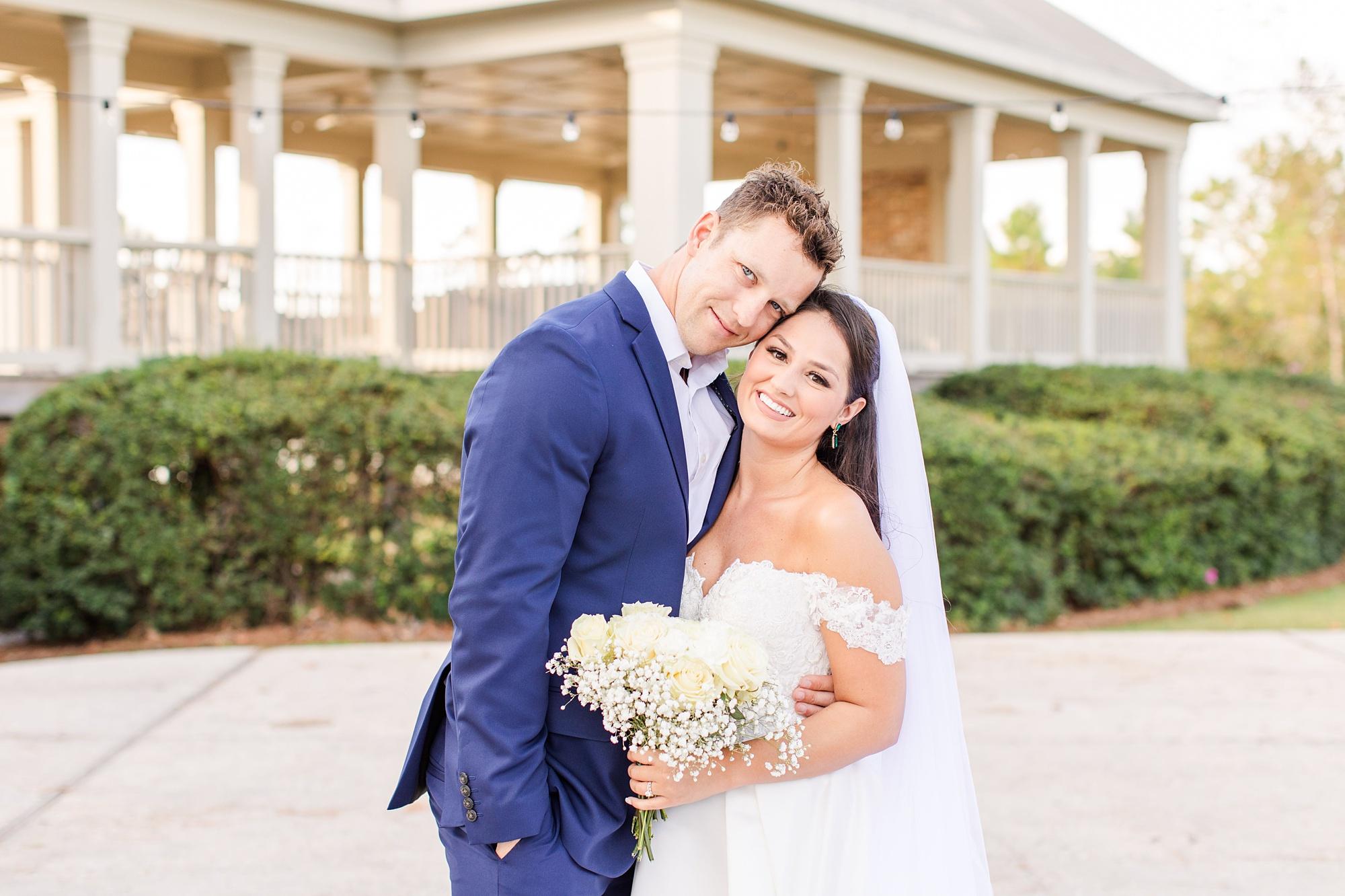 bride and groom pose in Orange Beach AL