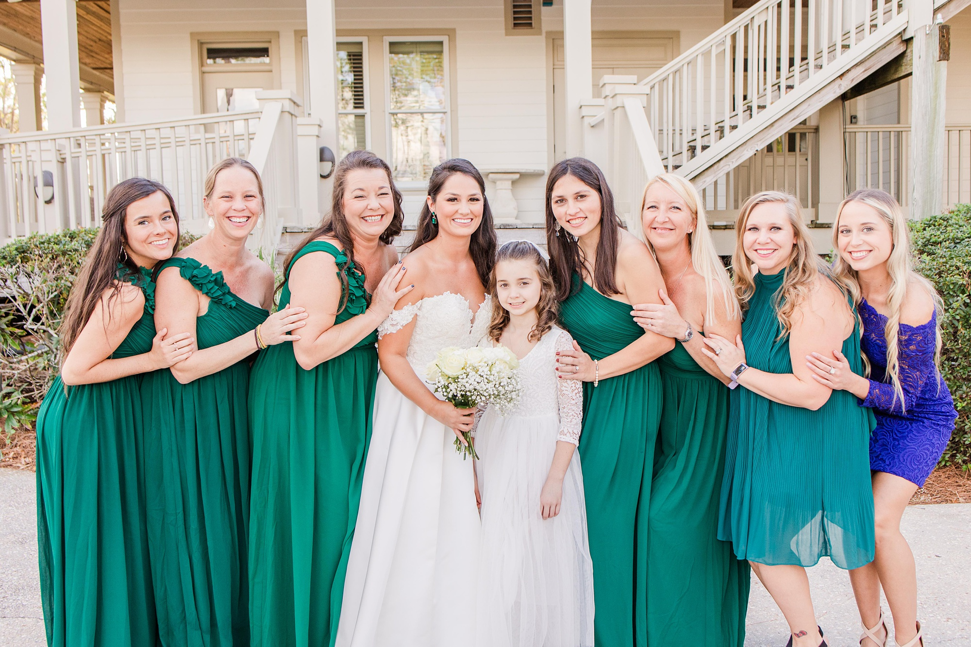 bridesmaids in emerald gowns for Heron Pointe at the Wharf wedding