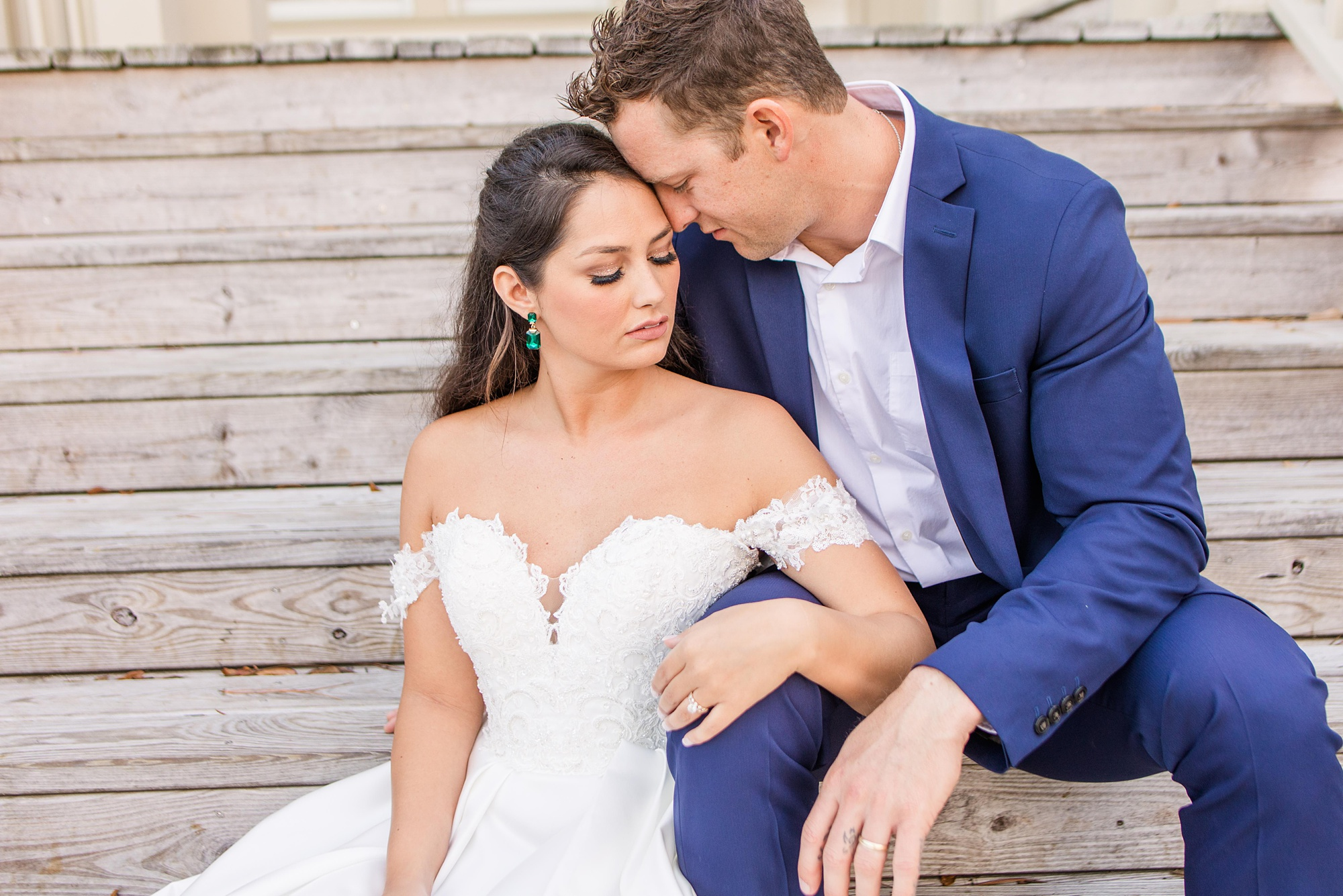 groom leans into bride's forehead during Heron Pointe at the Wharf wedding photos