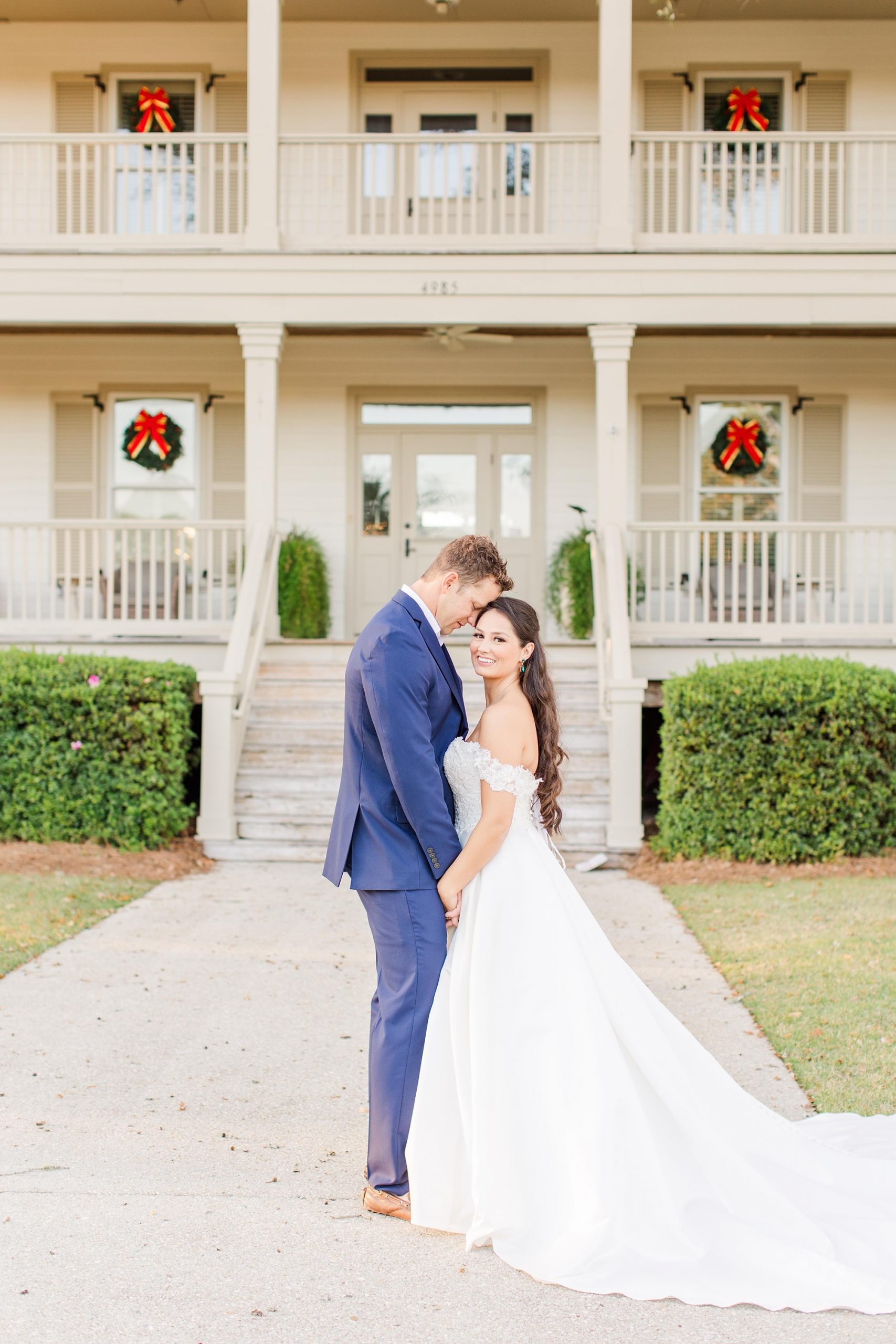 Orange Beach Al wedding photos with Christmas wreaths in backdrop