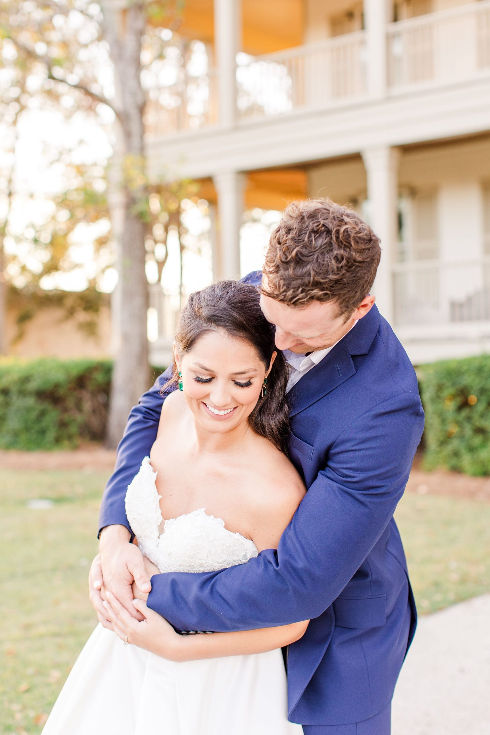 groom hugs bride and sways with her