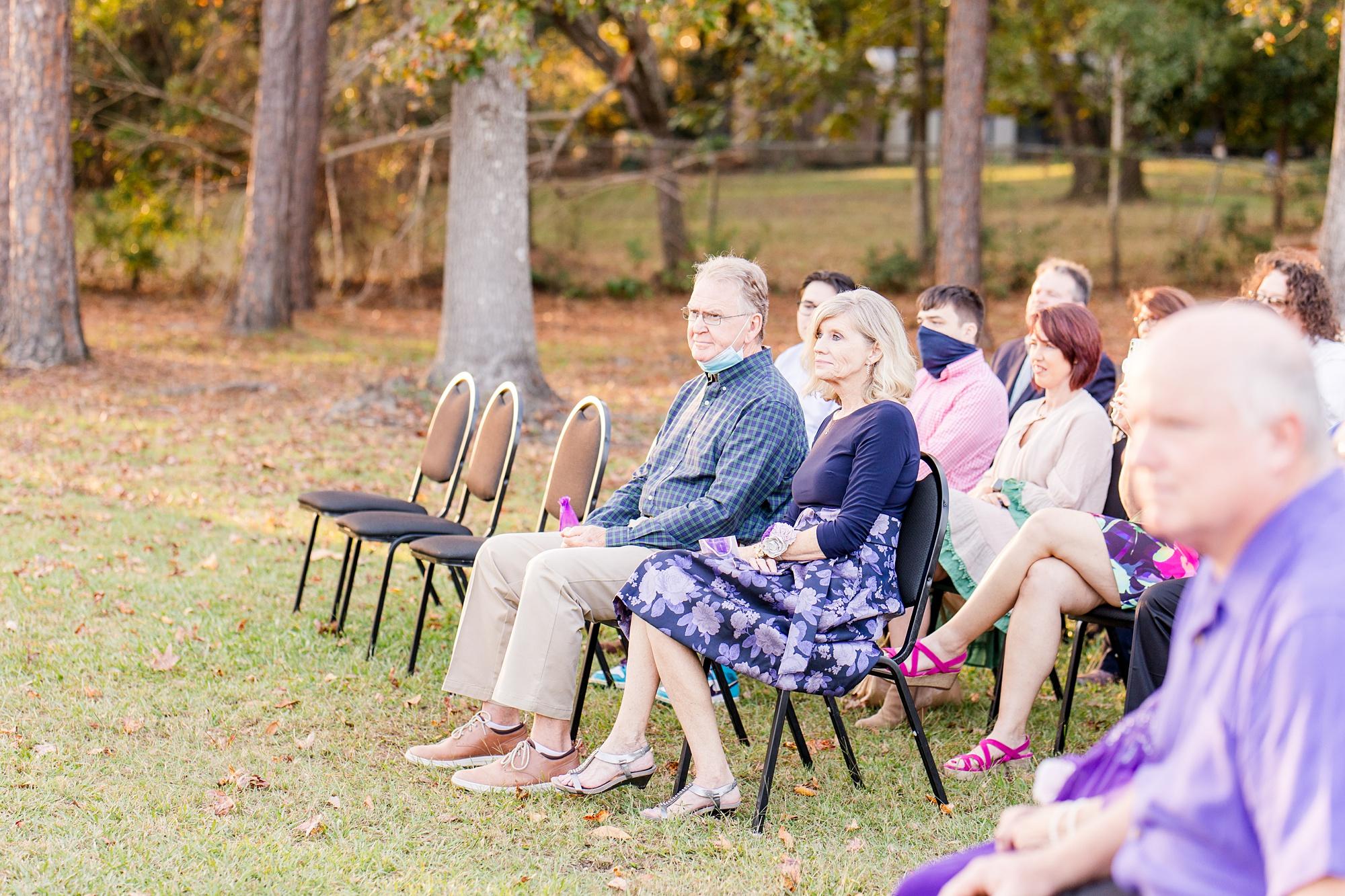 parents of groom watch ceremony in Alabama