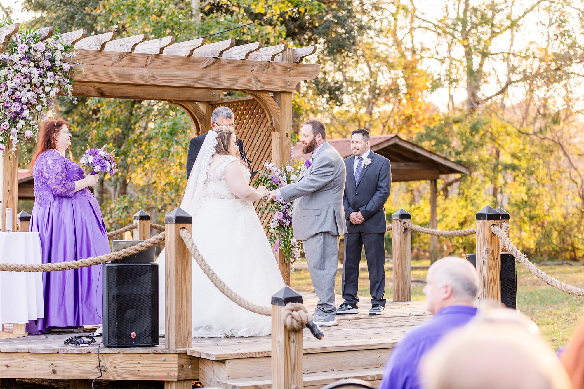 bride and groom exchange vows during waterfront intimate Satsuma wedding ceremony
