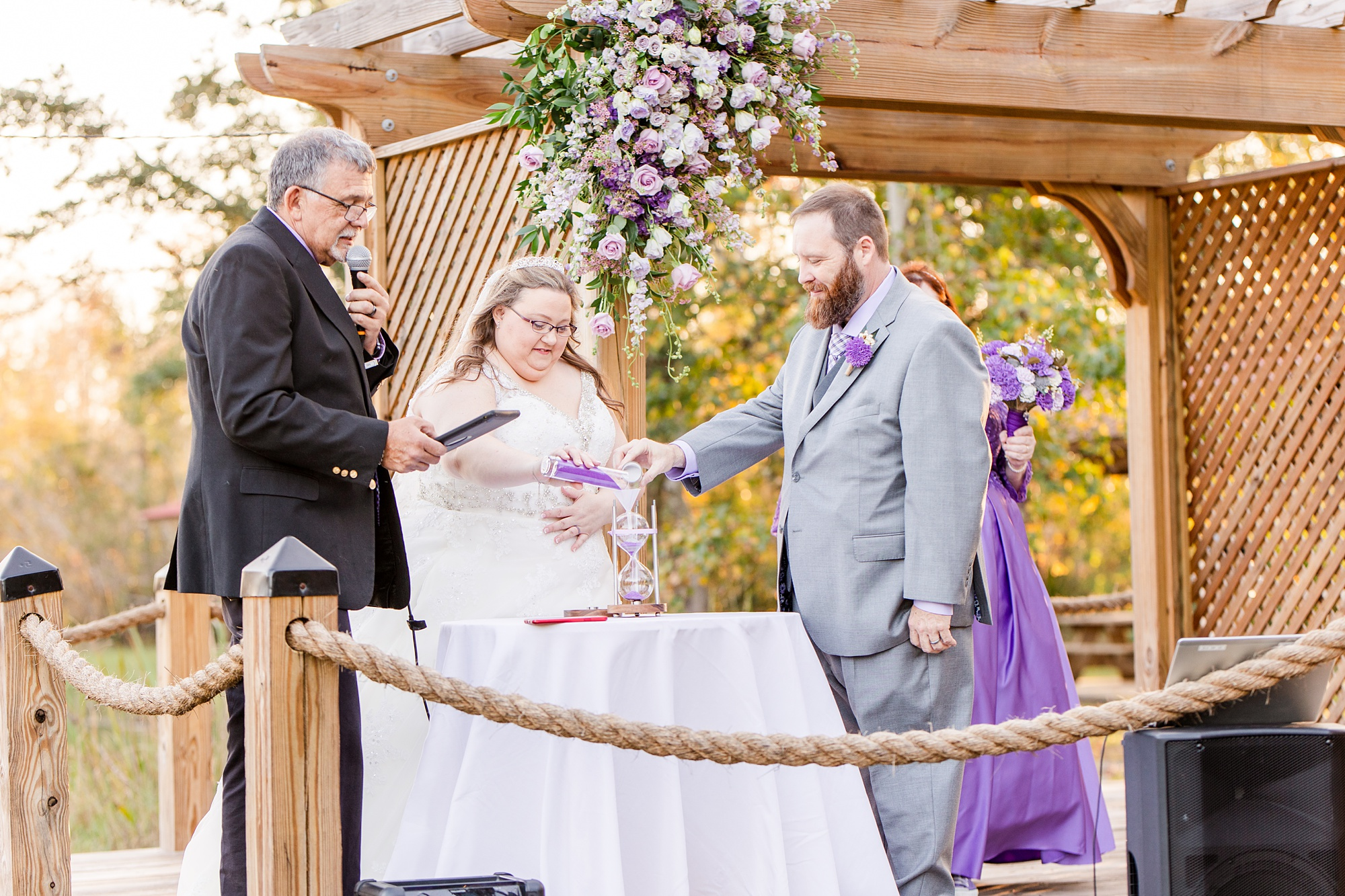 bride and groom participate in sand ceremony