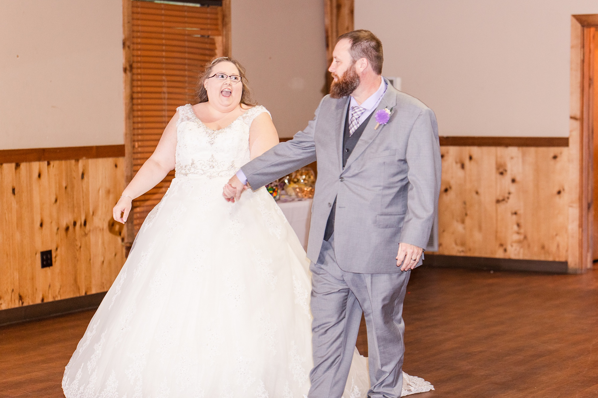 bride and groom enter wedding reception at Steel Creek Lodge