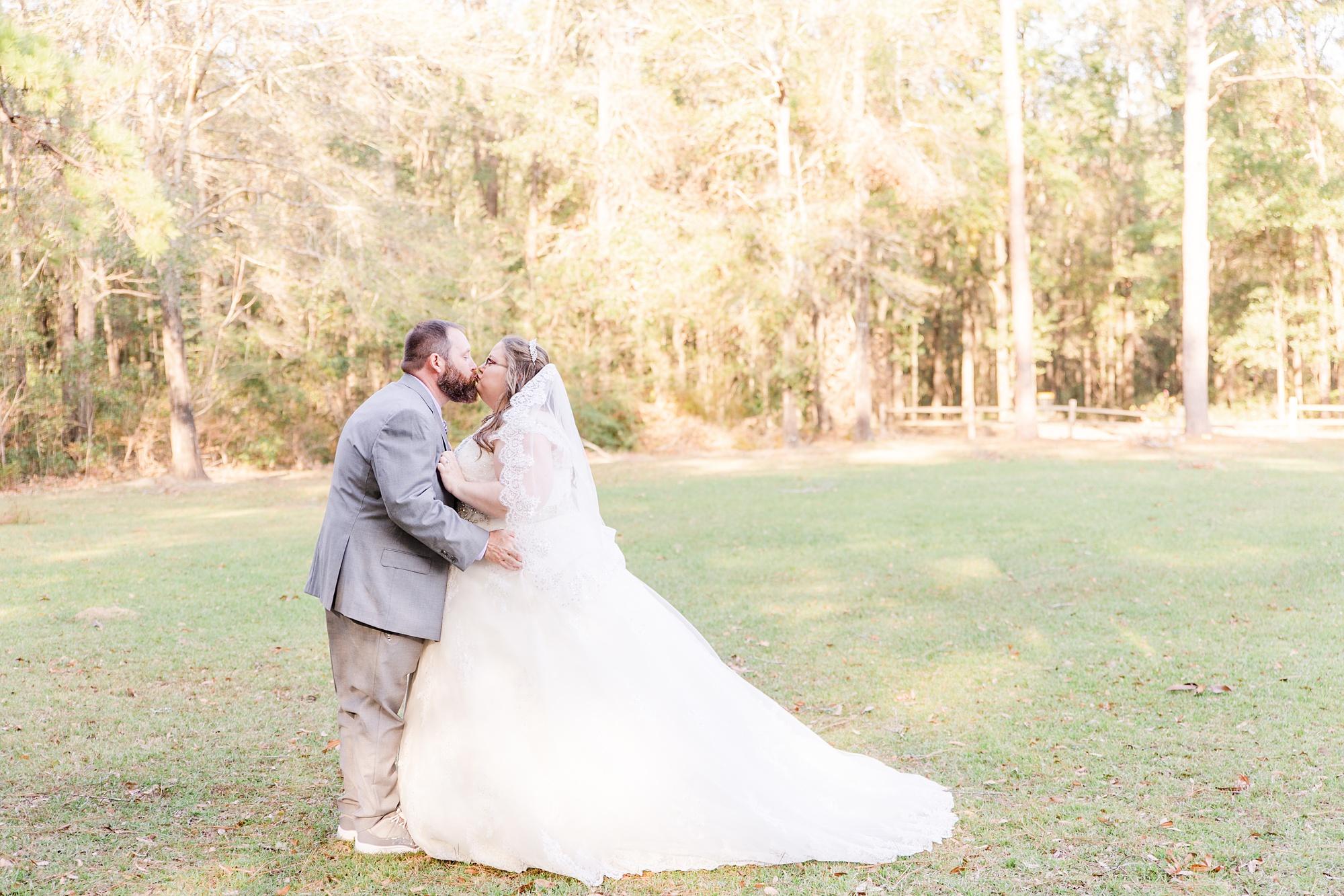 newlyweds kiss during intimate Satsuma wedding photos