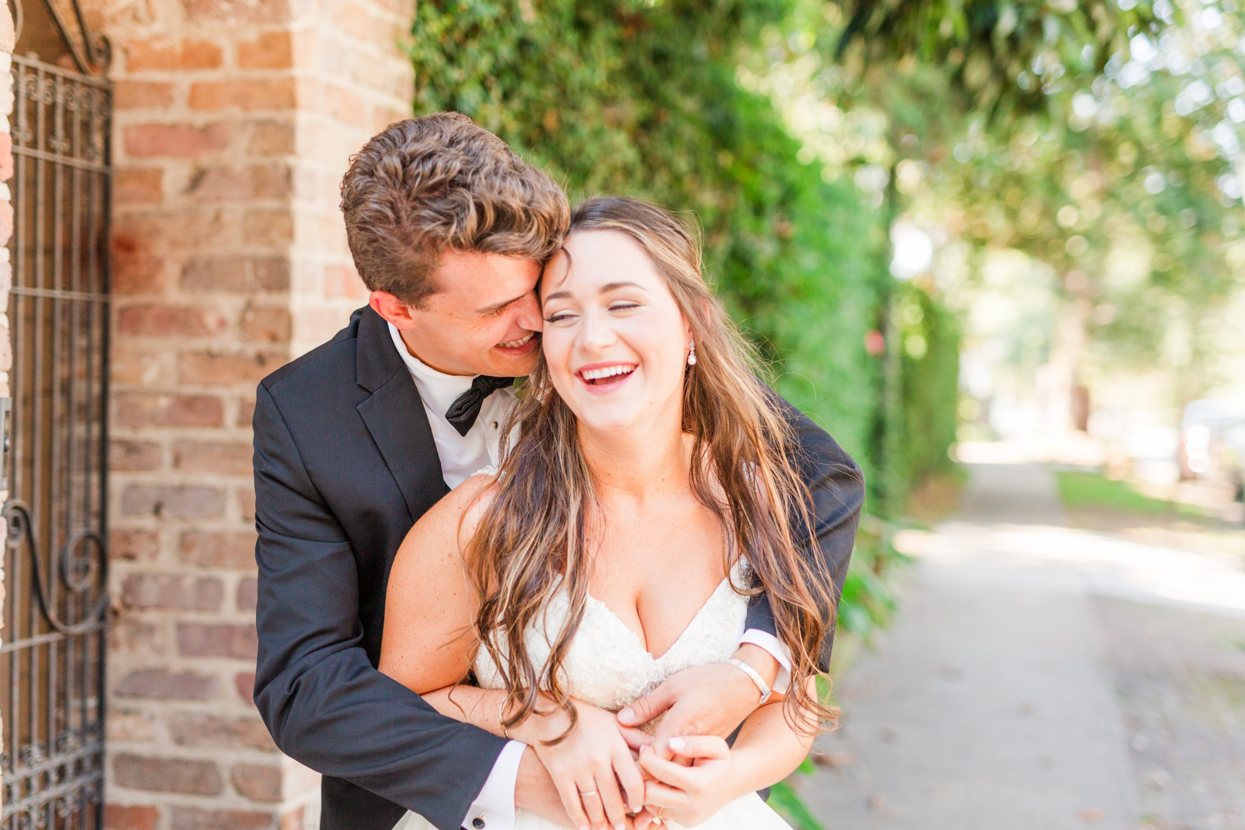 Alabama couple laughs during wedding portraits
