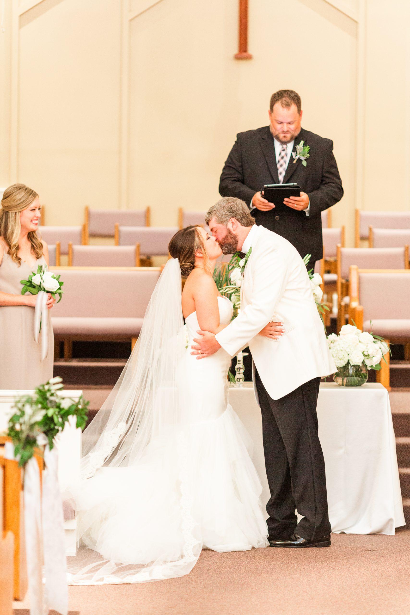Alabama couple kisses during church wedding ceremony
