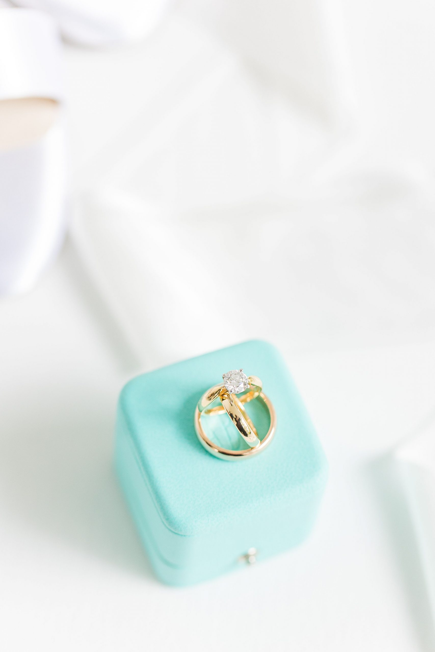 bride's Tiffany & Co. ring on teal box