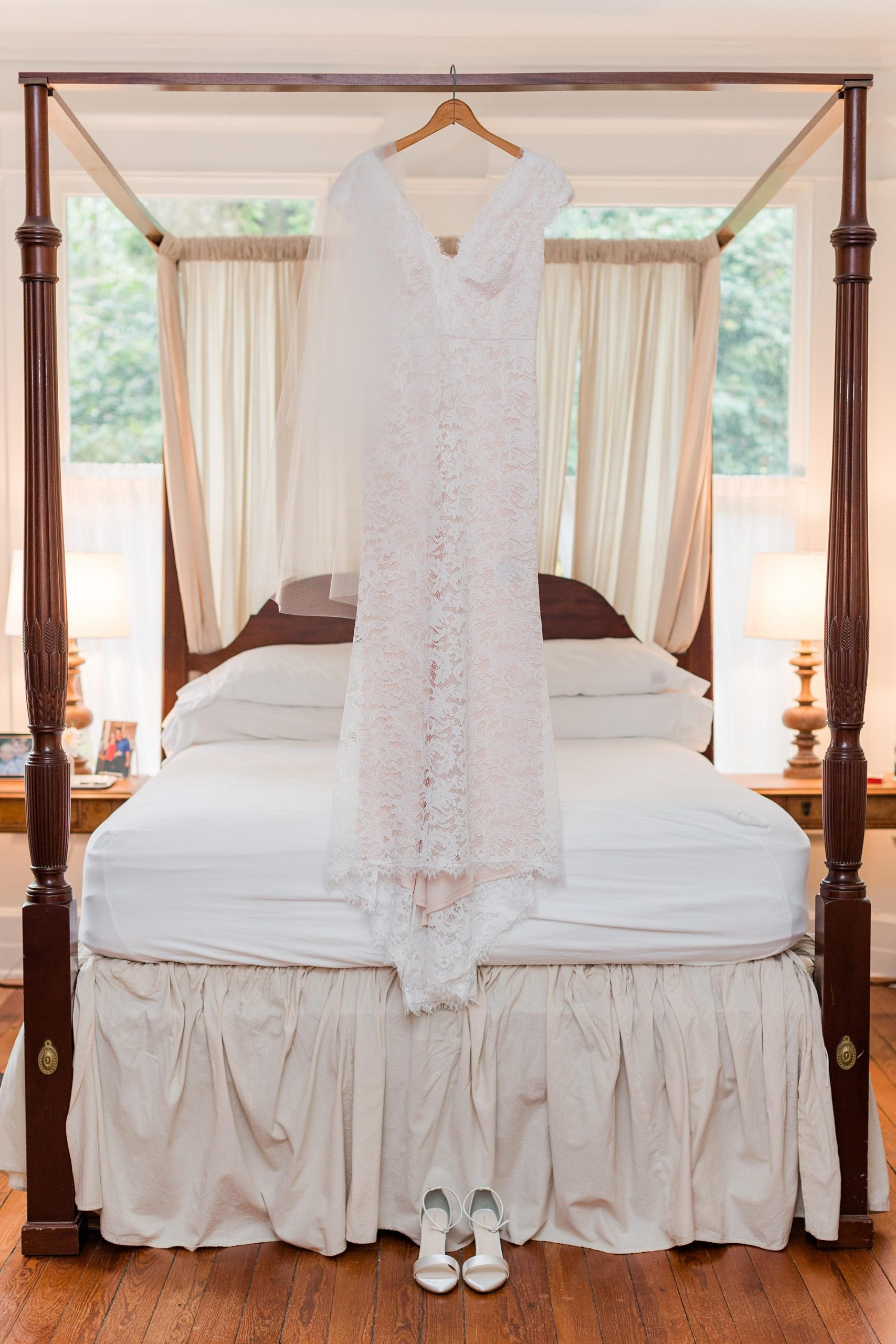 wedding gown hangs on bed in childhood home