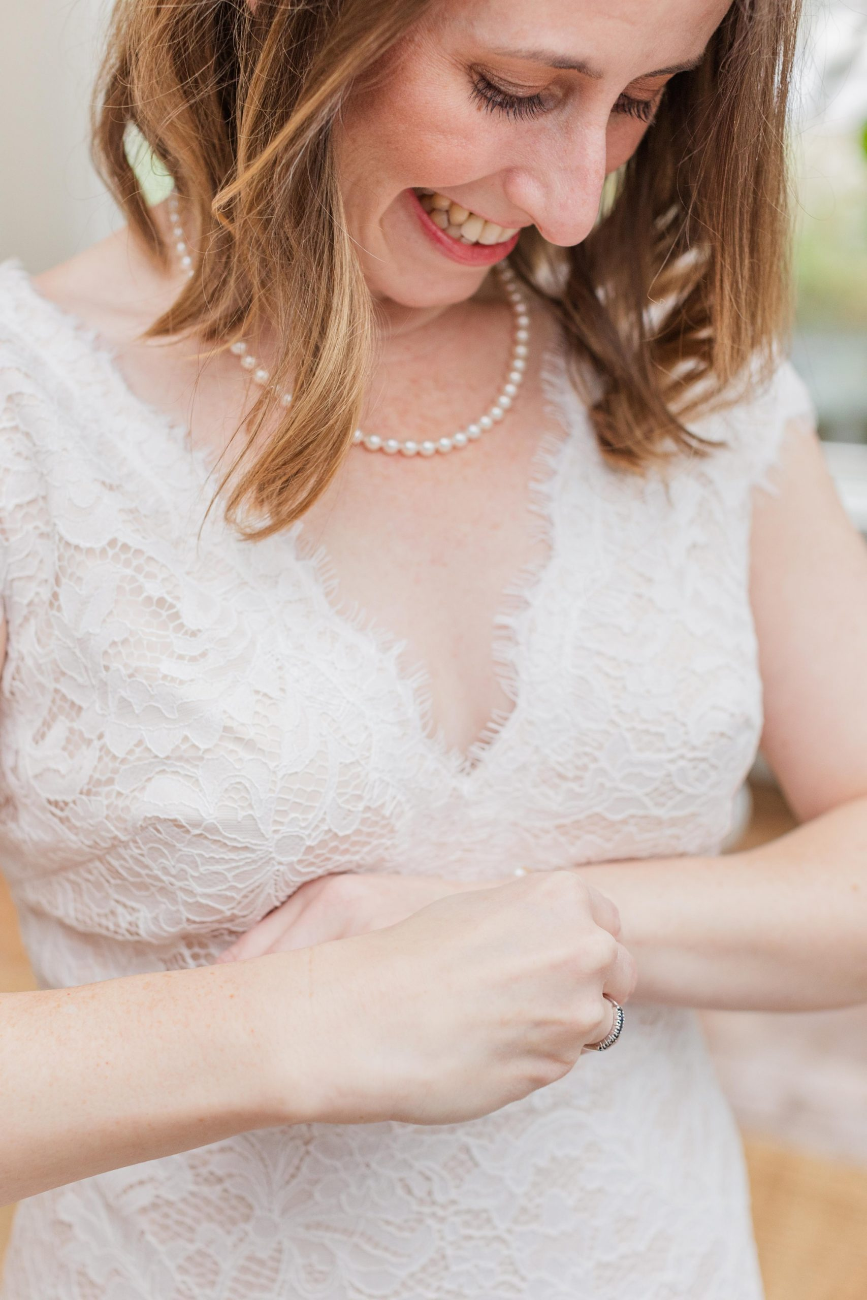 bride adjusts bracelet on wedding day in Mobile AL