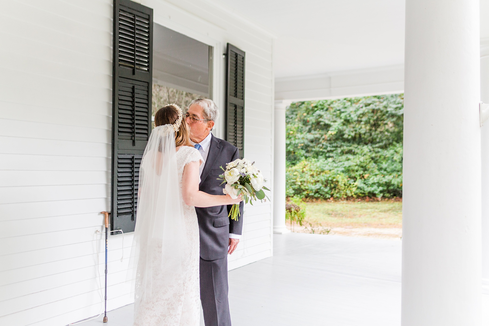 dad kisses bride during first look