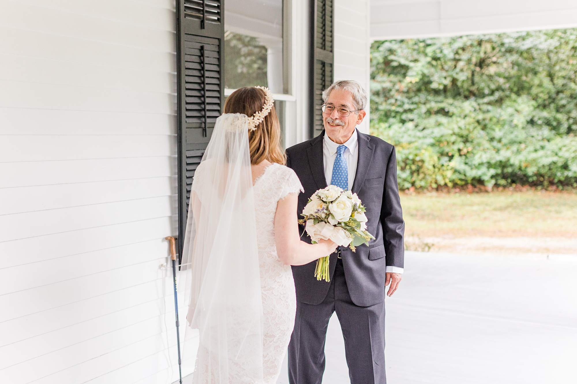 bride and dad have first look on front porch