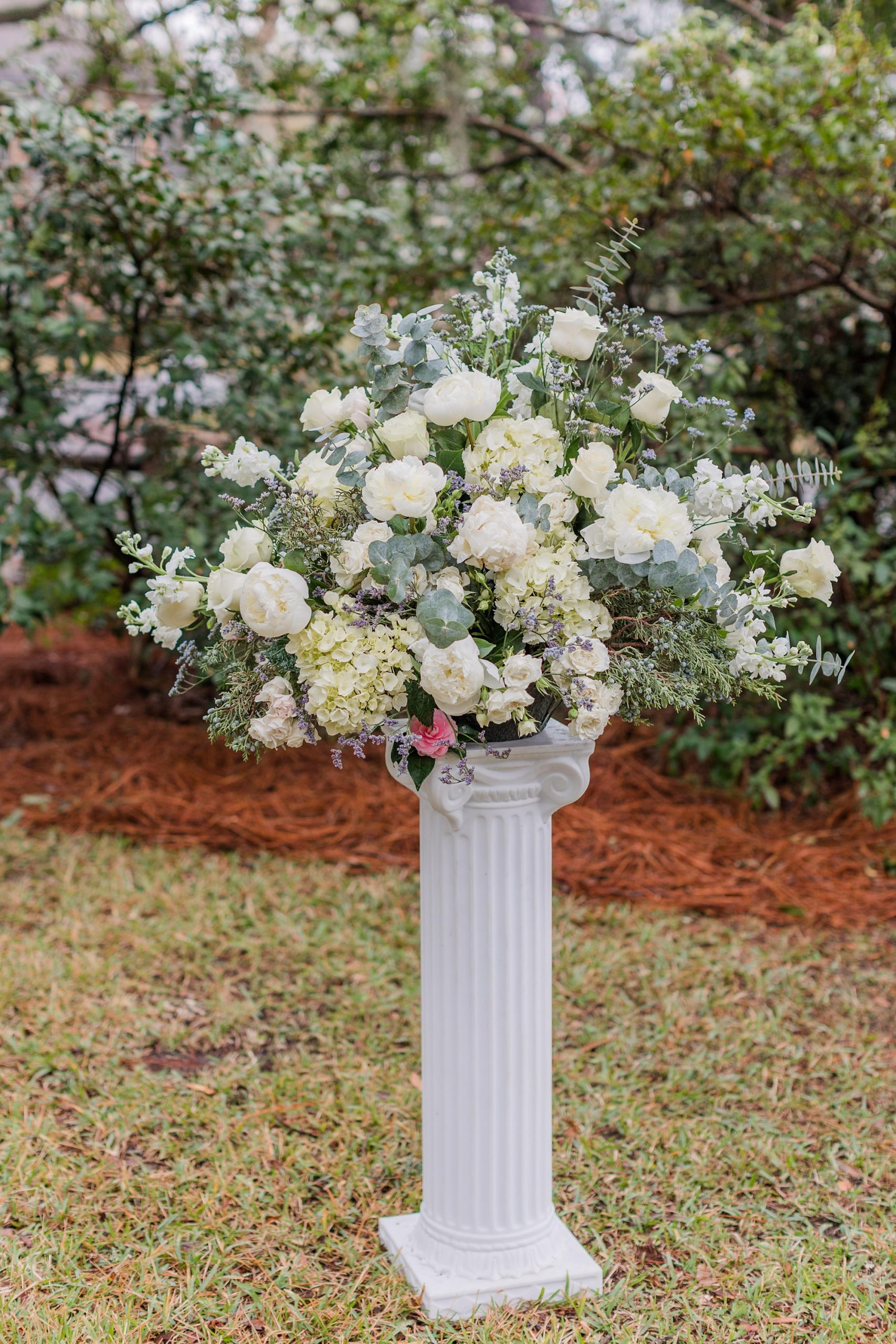 elegant floral display for intimate Springhill wedding ceremony in front yard