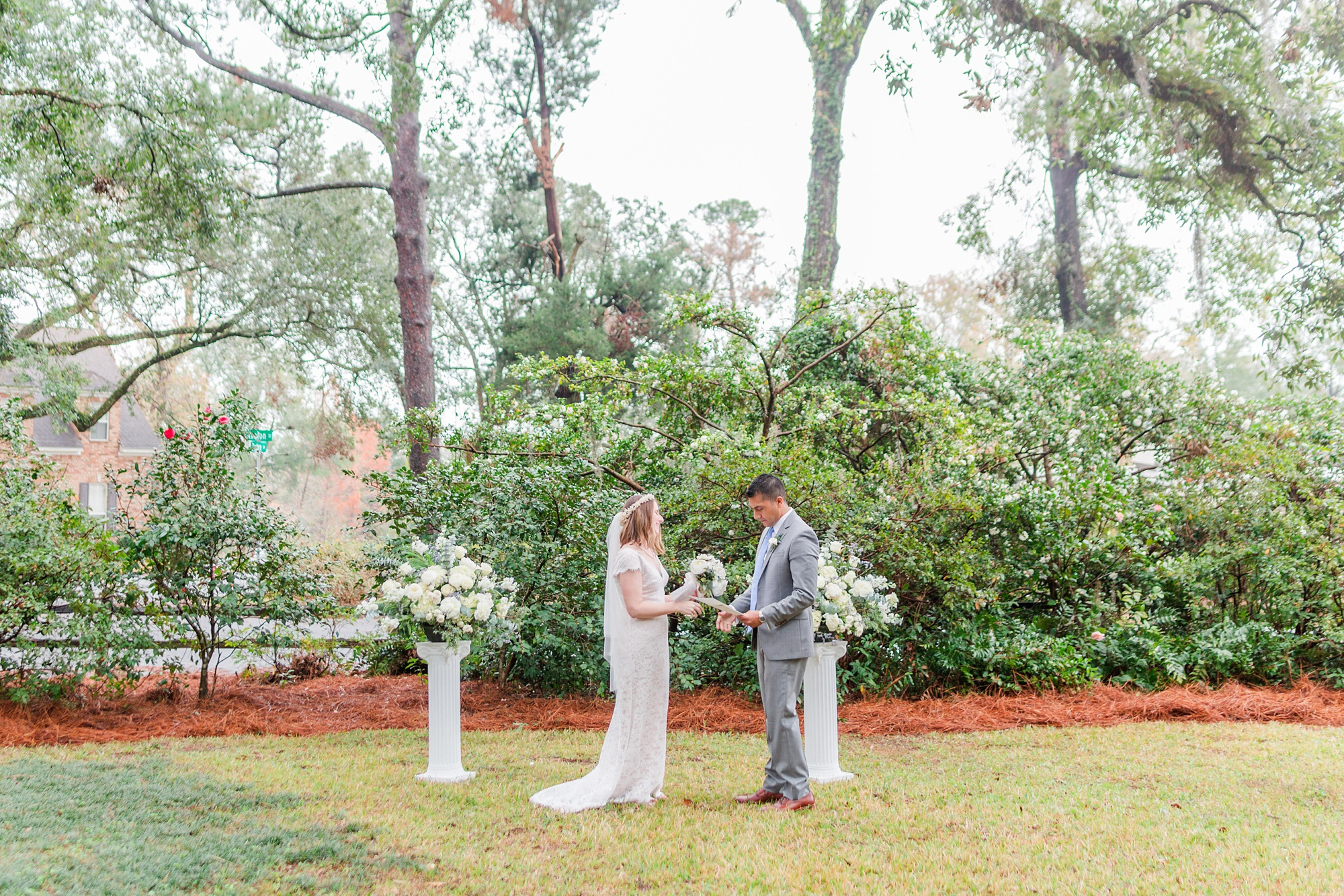 intimate Springhill wedding ceremony for bride and groom in backyard