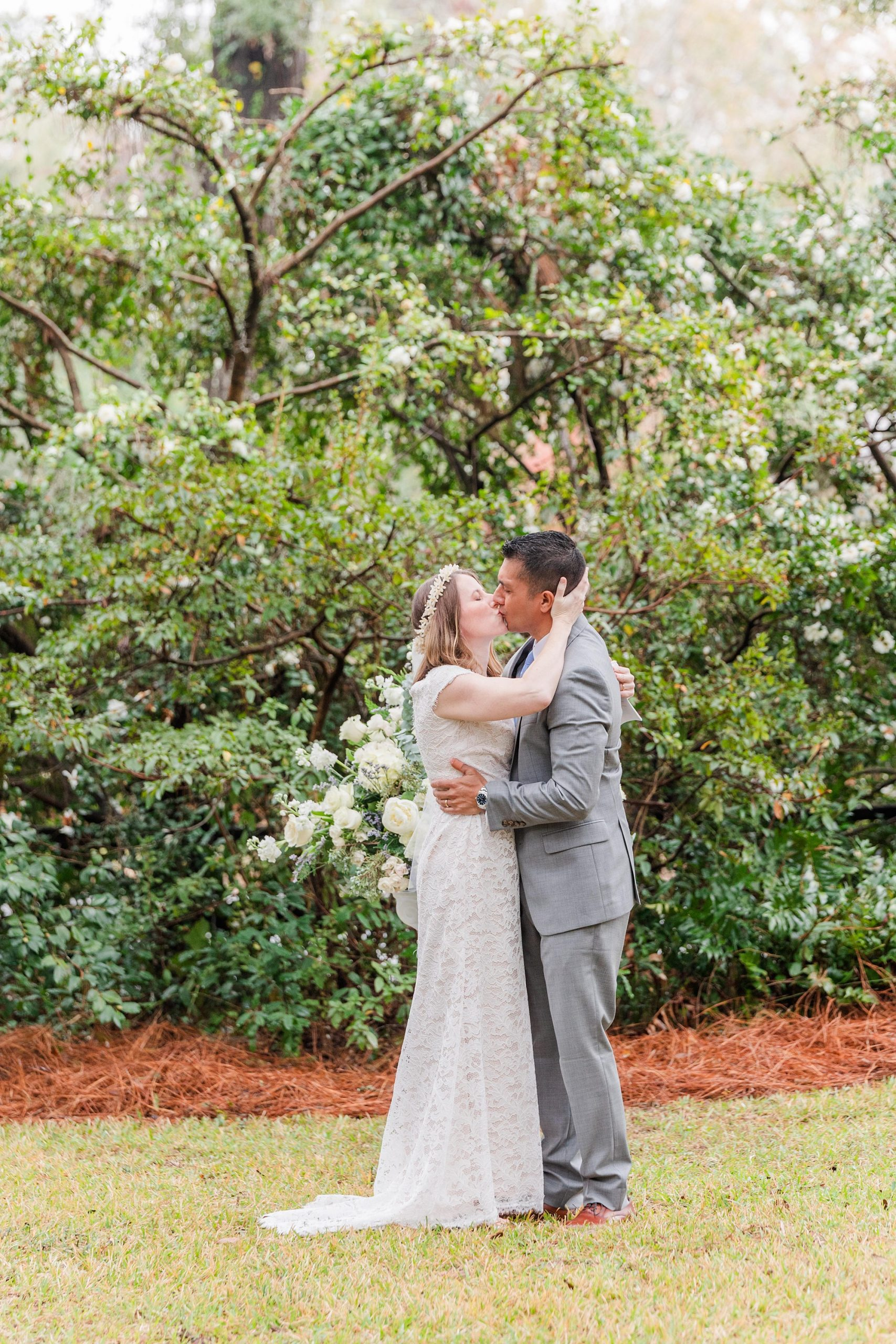 newlyweds kiss during intimate Springhill wedding ceremony