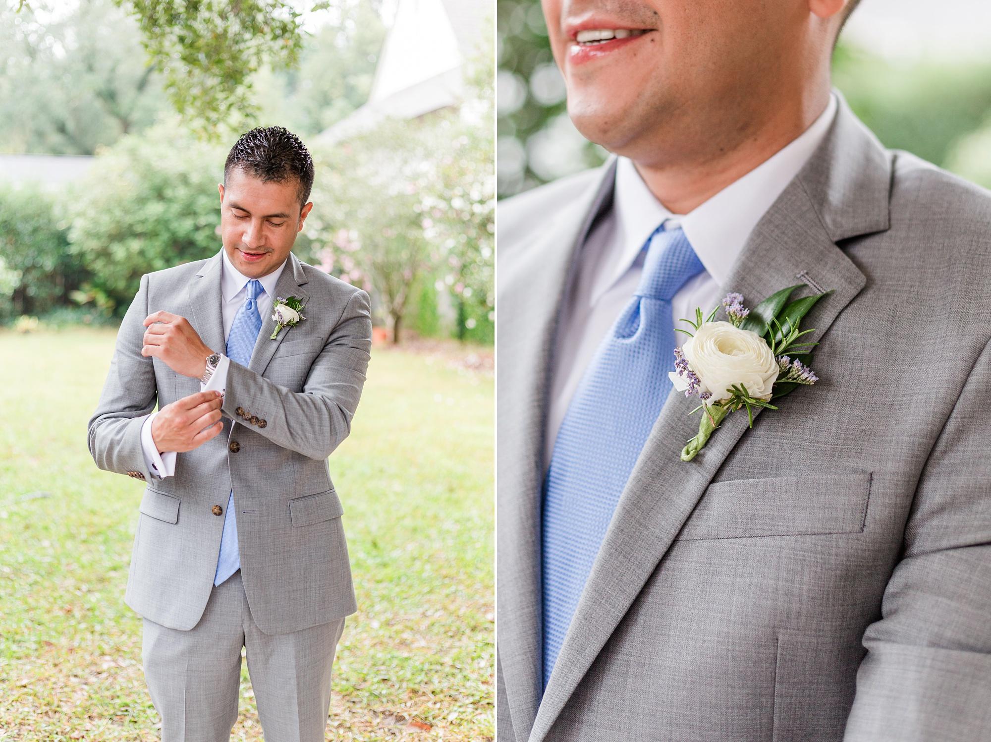 groom in grey suit with blue tie