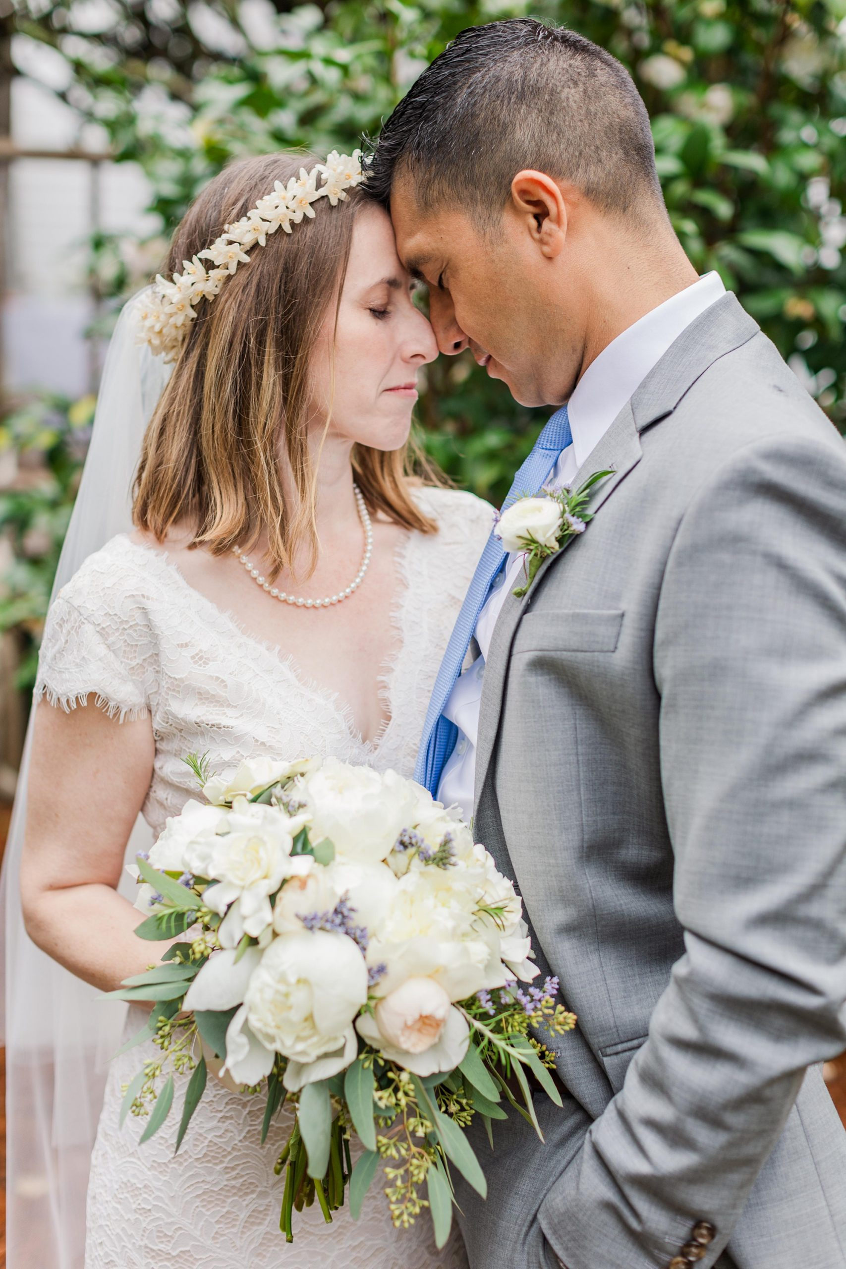 bride and groom stand with foreheads touching during intimate Springhill wedding photos