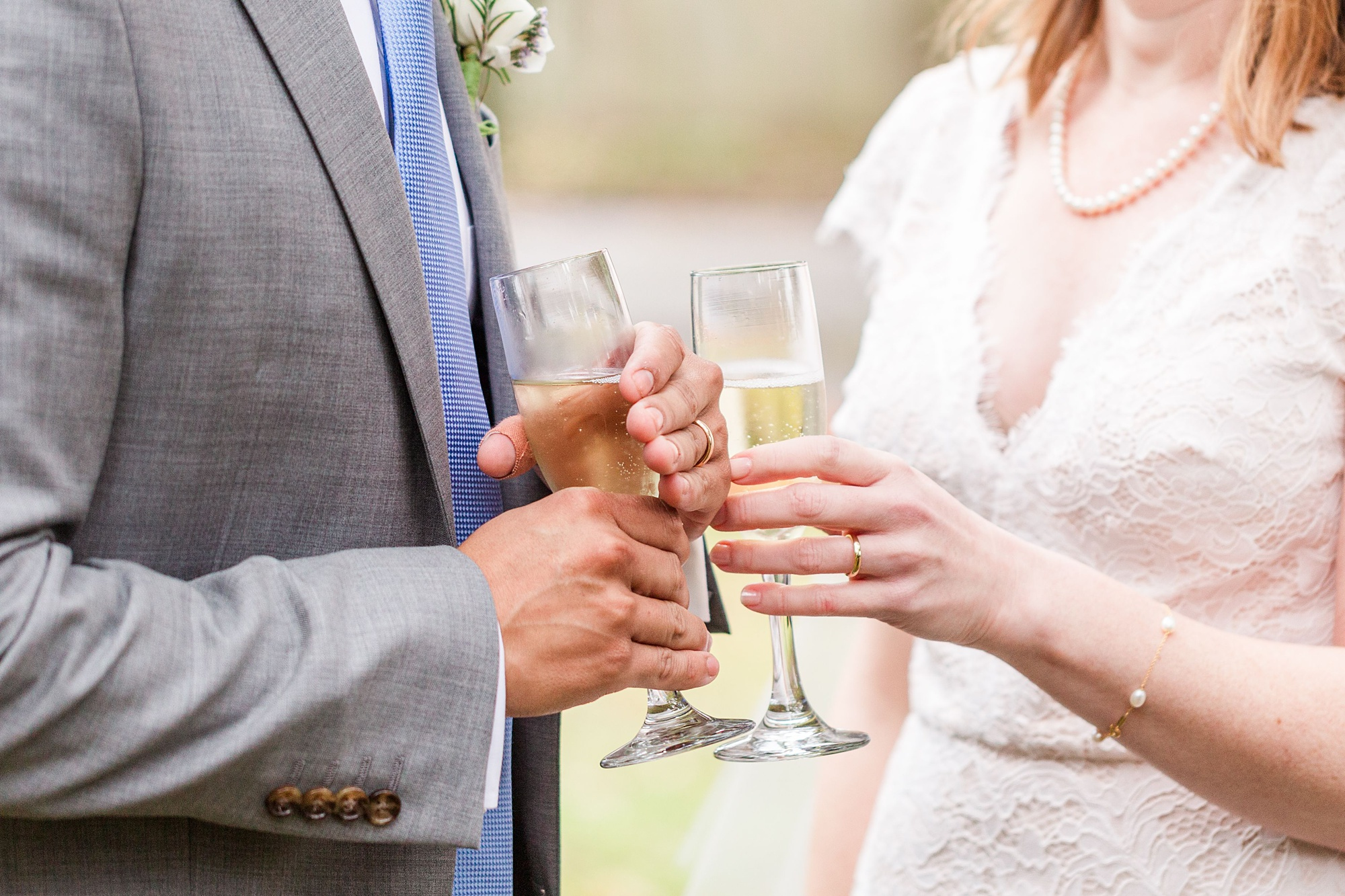 newlyweds toast wedding with champagne