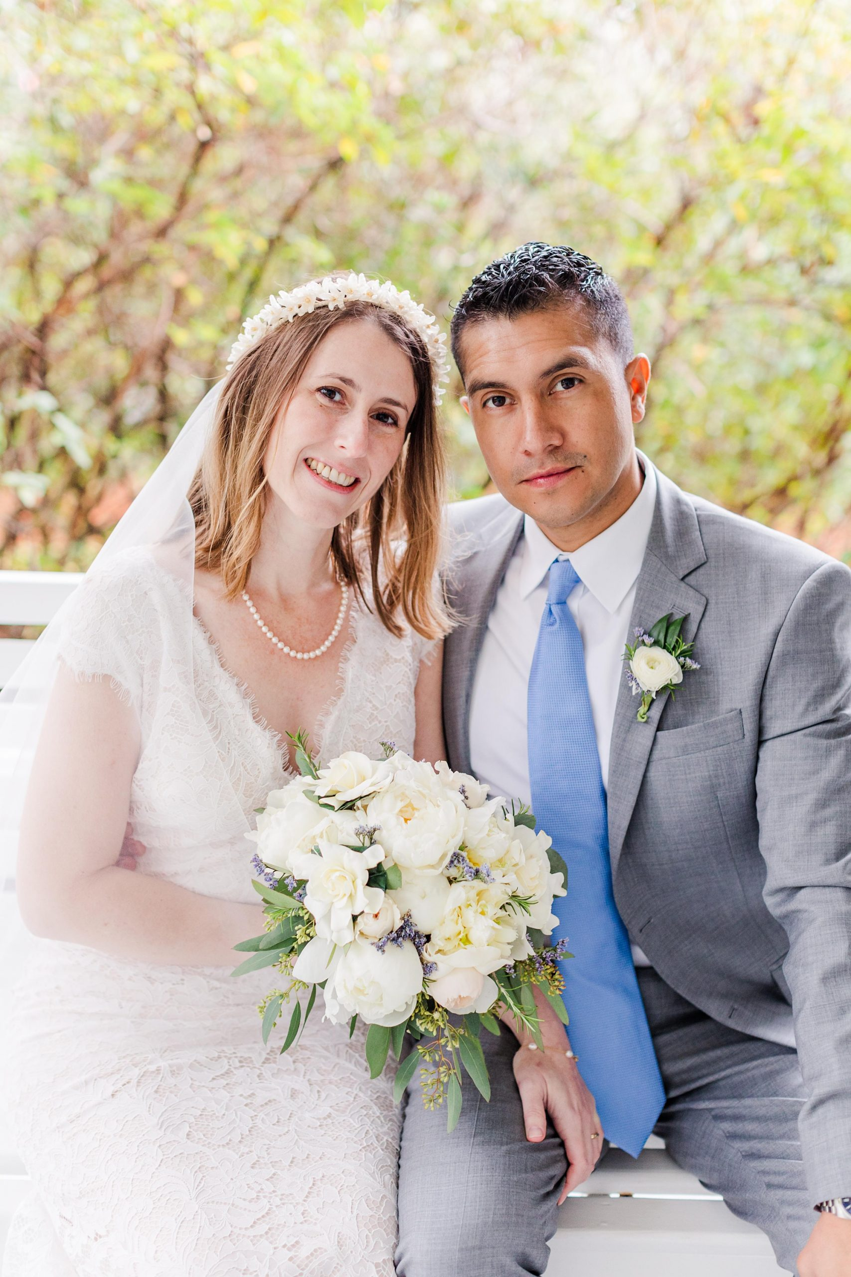 newlyweds pose on front porch swing during intimate Springhill wedding day