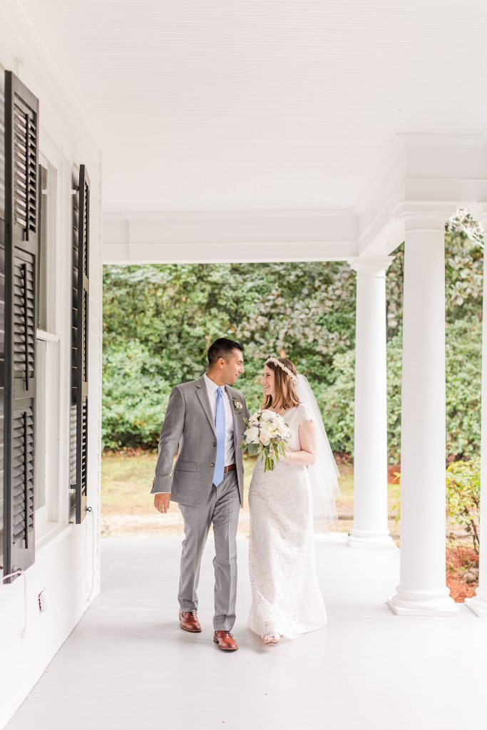 bride and groom walk on porch in Mobile AL