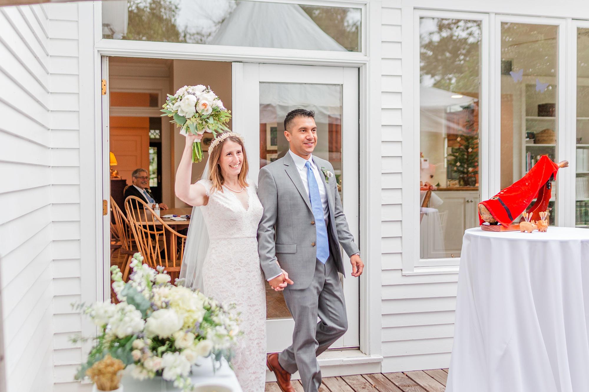 bride and groom enter intimate Springhill wedding reception