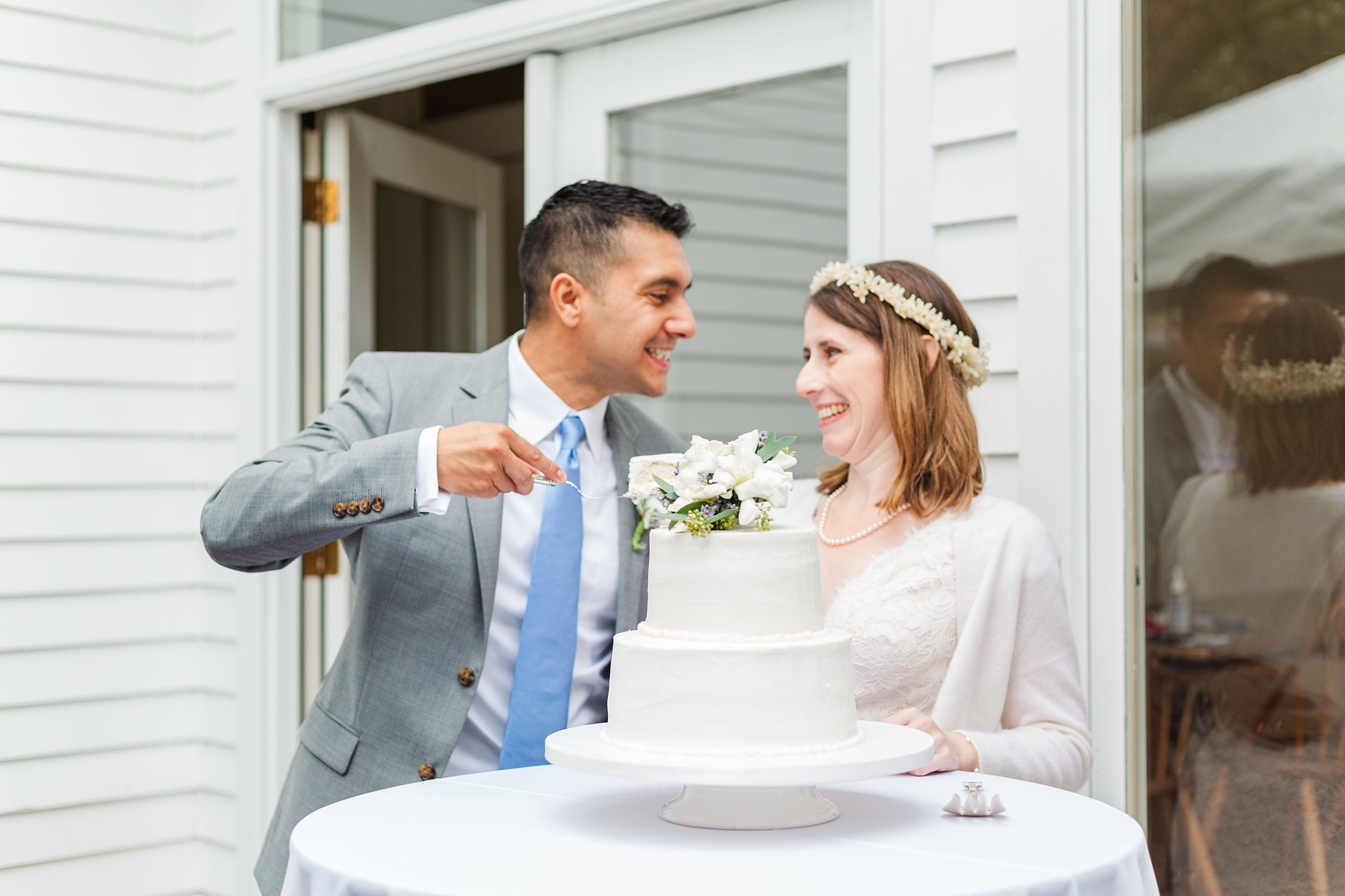newlyweds cut wedding cake during Mobile AL wedding day