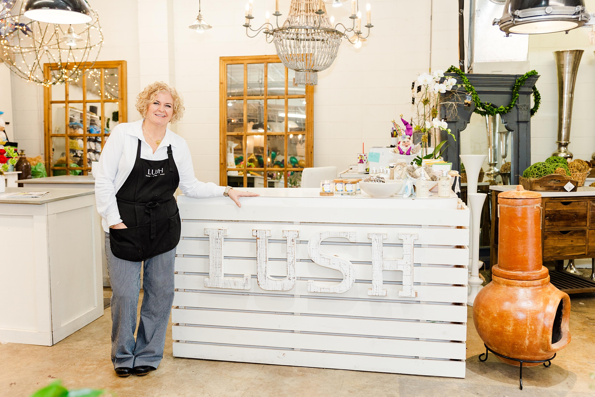 owner poses with custom counter at LUSH