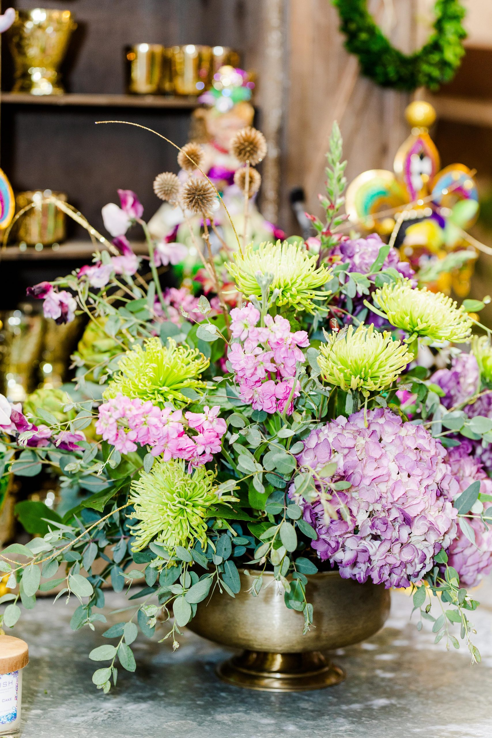 purple and green floral display for Mardi Gras