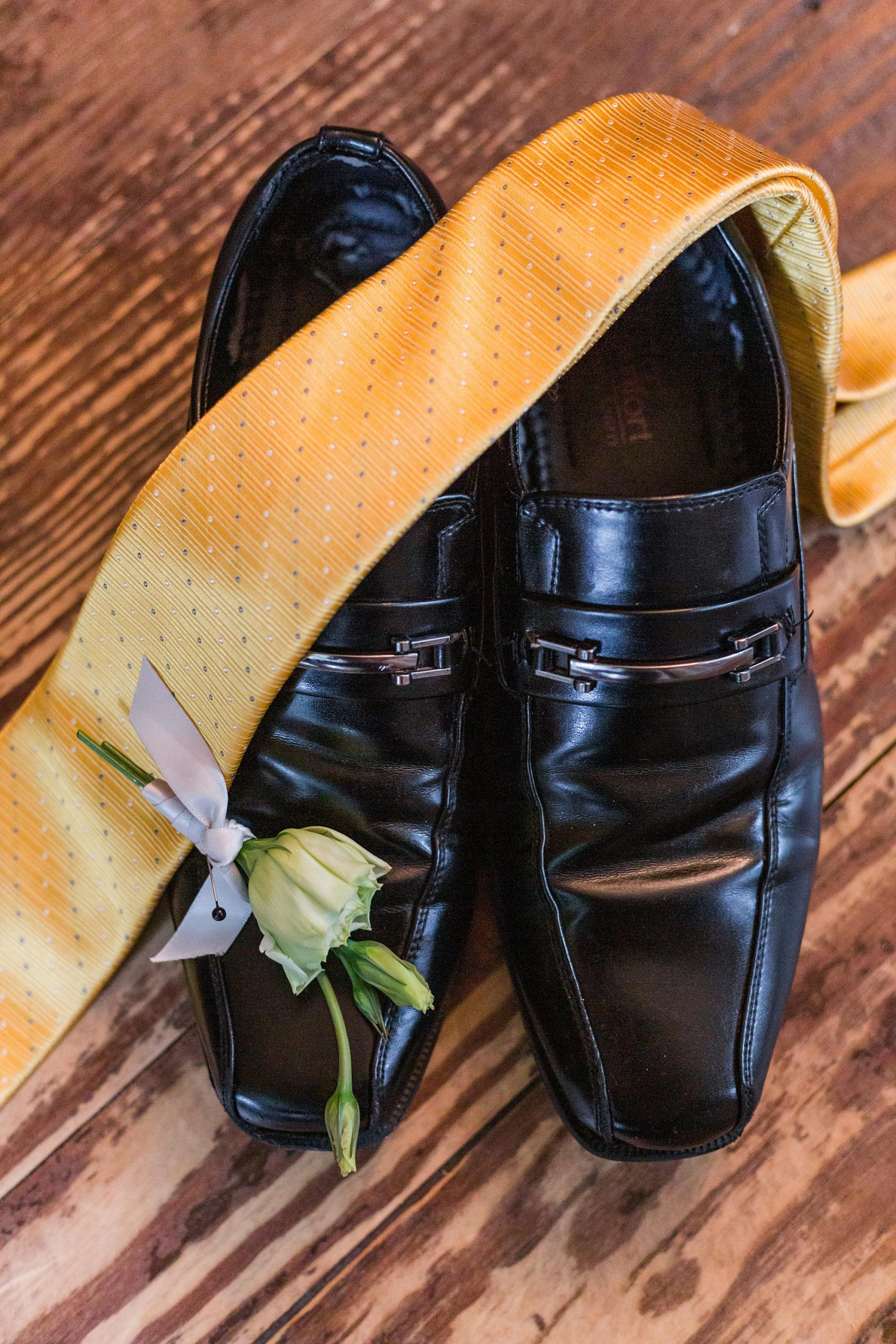 groom's shoes, yellow tie, and boutonniere for Intimate Mobile AL Wedding