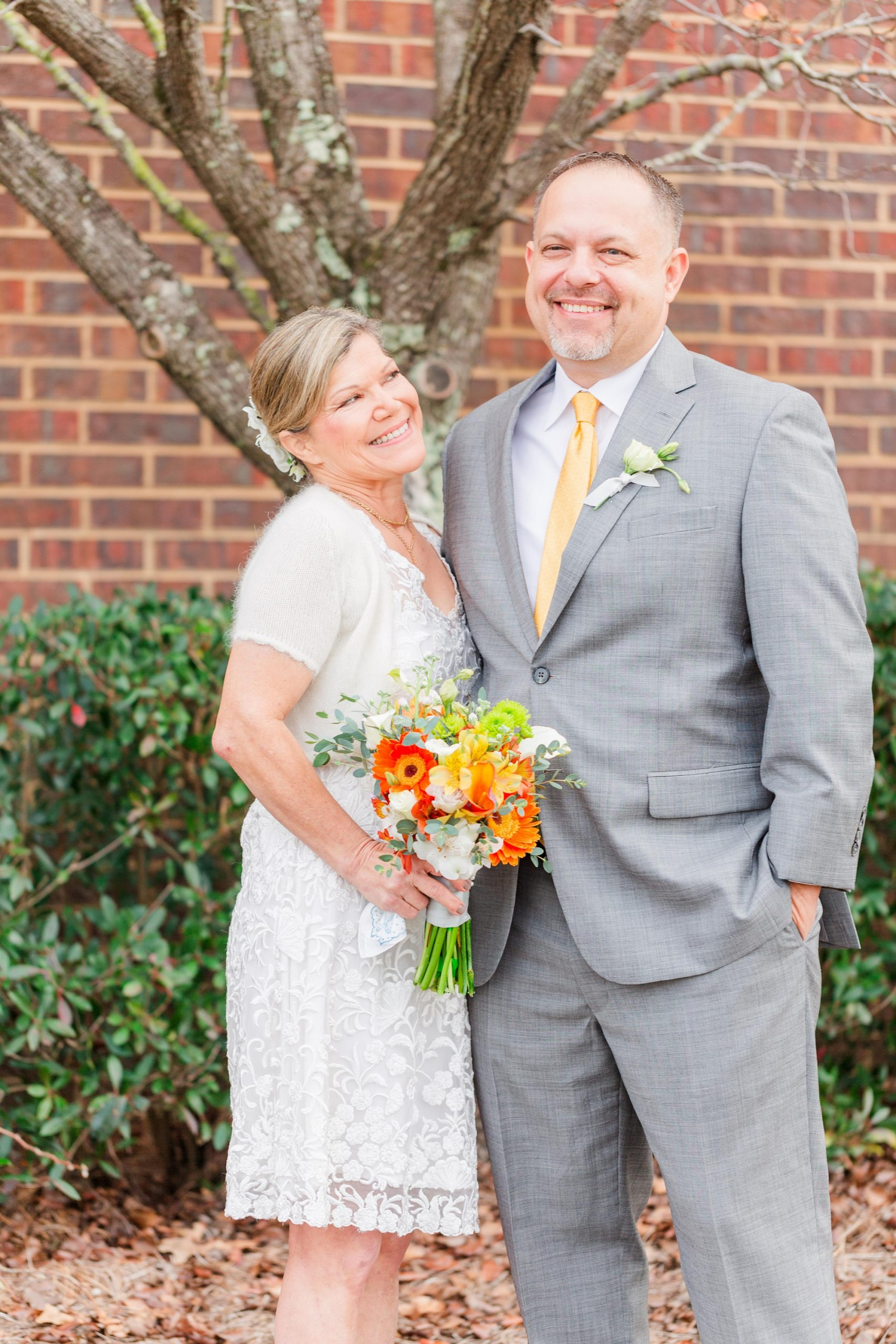 newlyweds pose together by Redemption Church in Mobile AL
