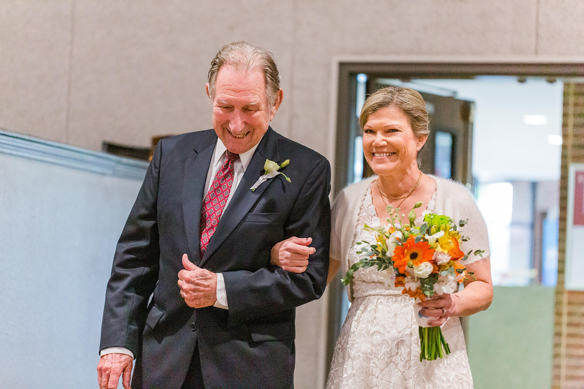 bride walks down the aisle with father before traditional Alabama church wedding