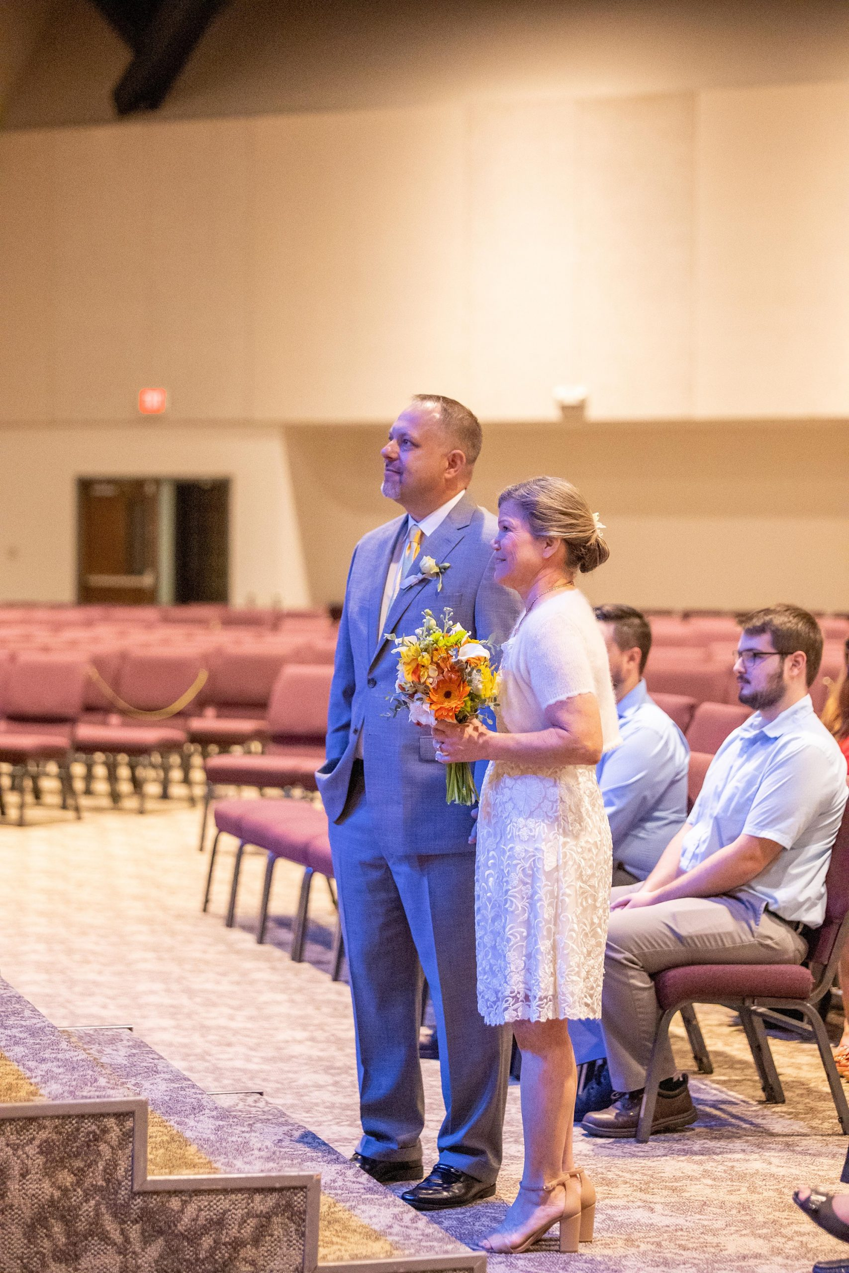 bride and groom listen to talk during traditional Alabama church wedding