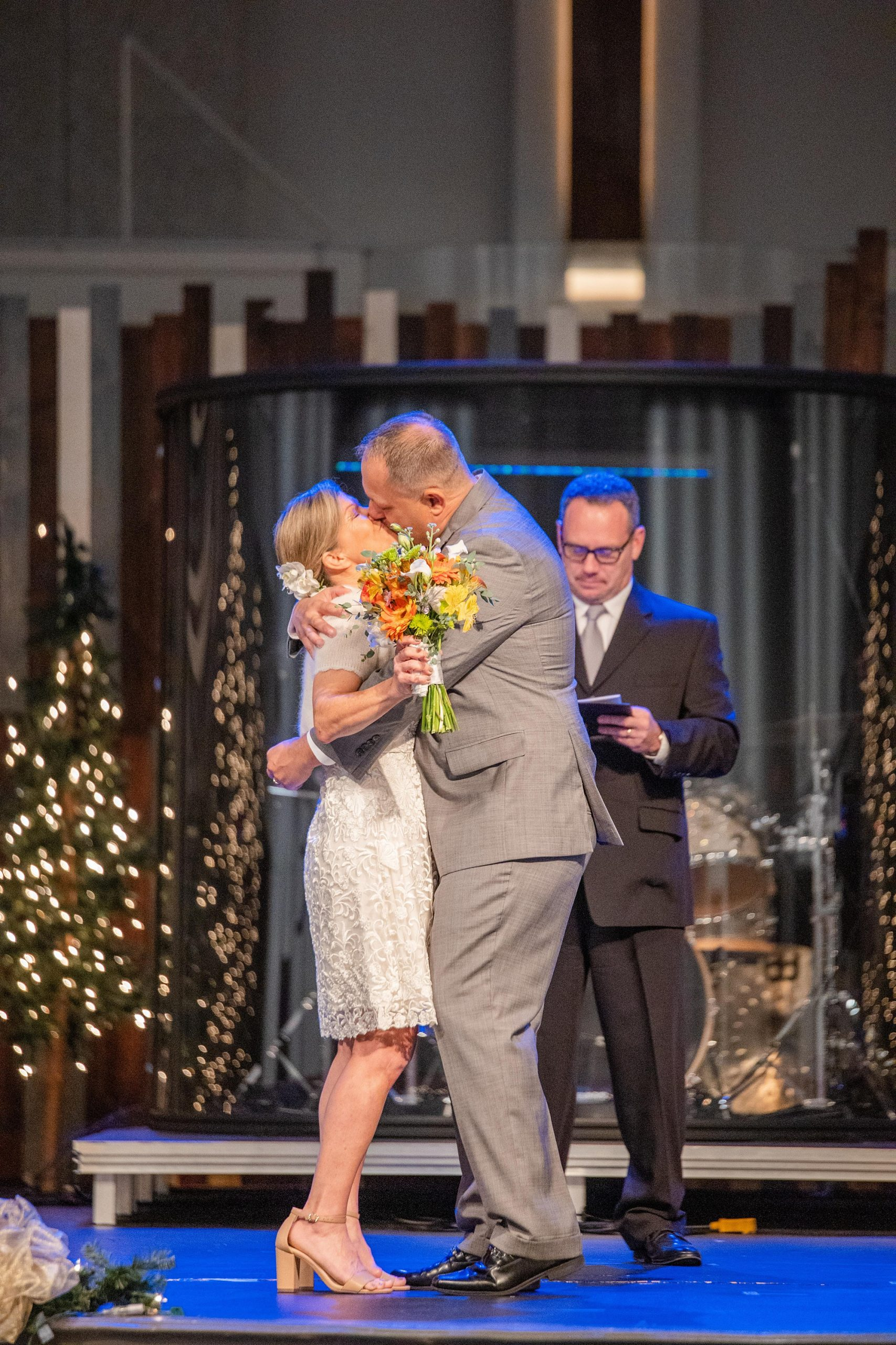 bride and groom kiss during traditional Alabama church wedding