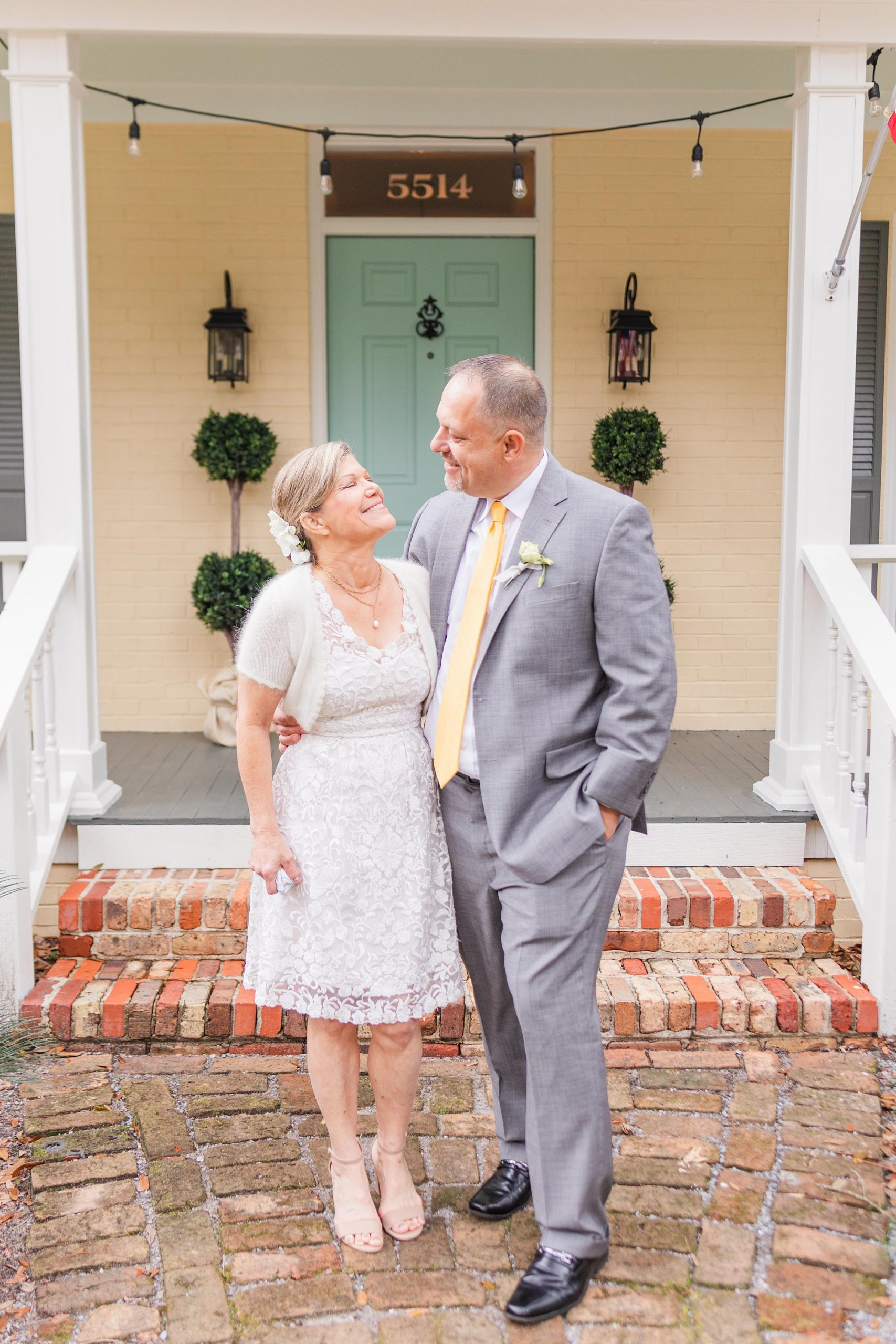 newlyweds smile at each other during winter wedding photos in Spring Hill