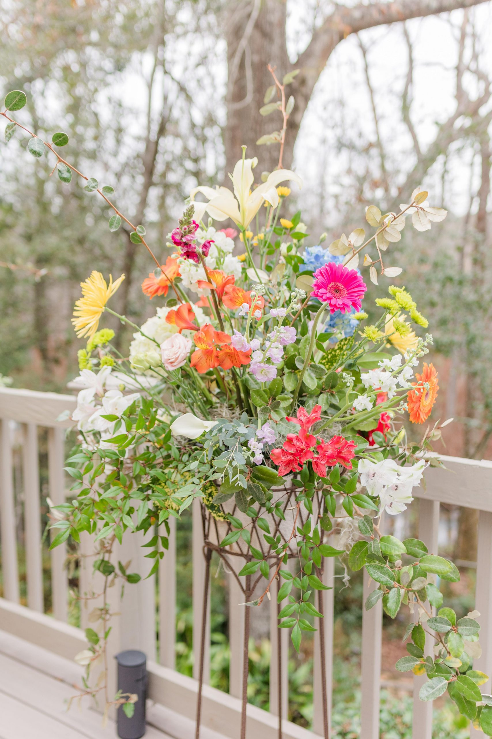 bright wildflower floral display during intimate Mobile AL wedding reception