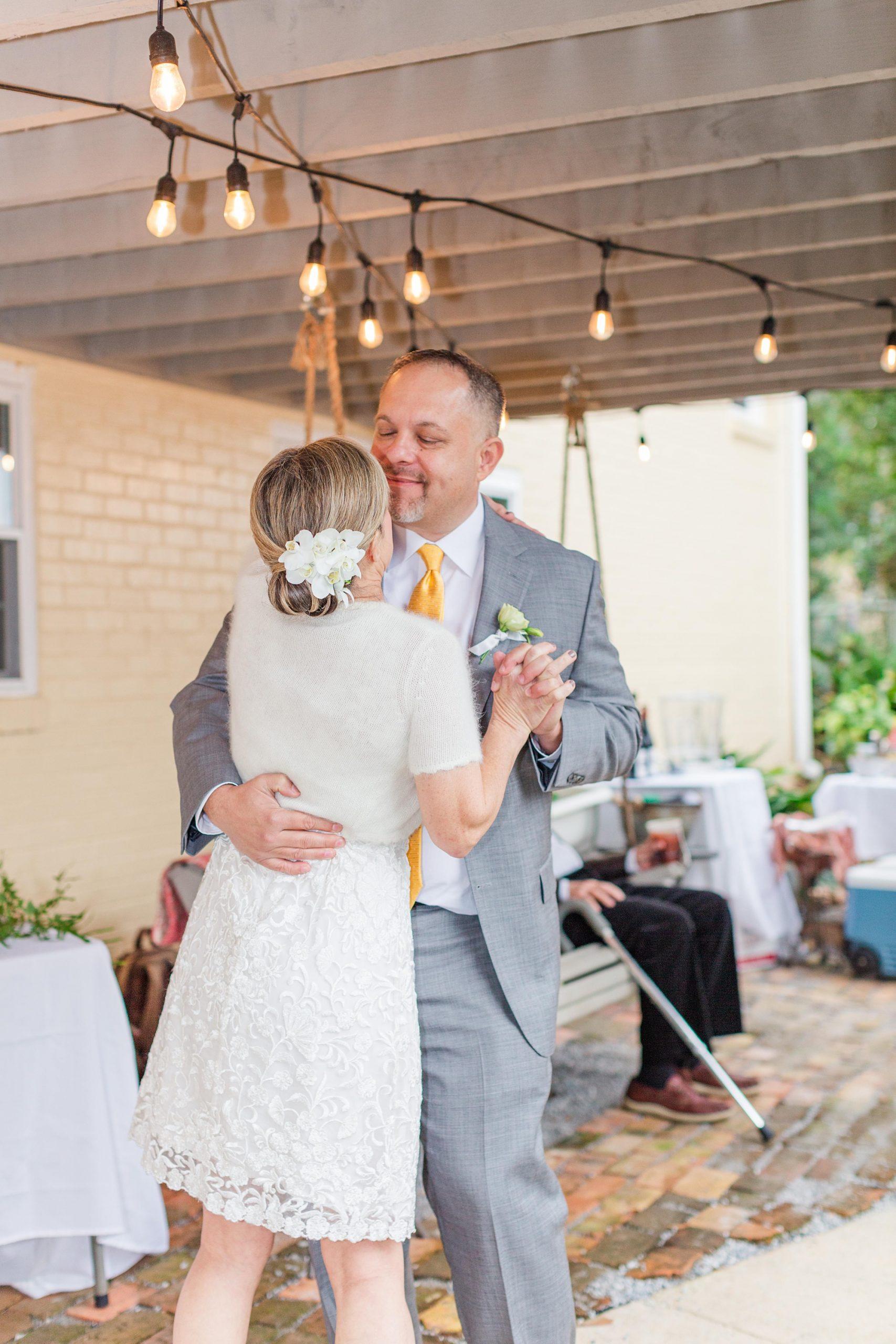 newlyweds dance during Spring Hill backyard wedding reception