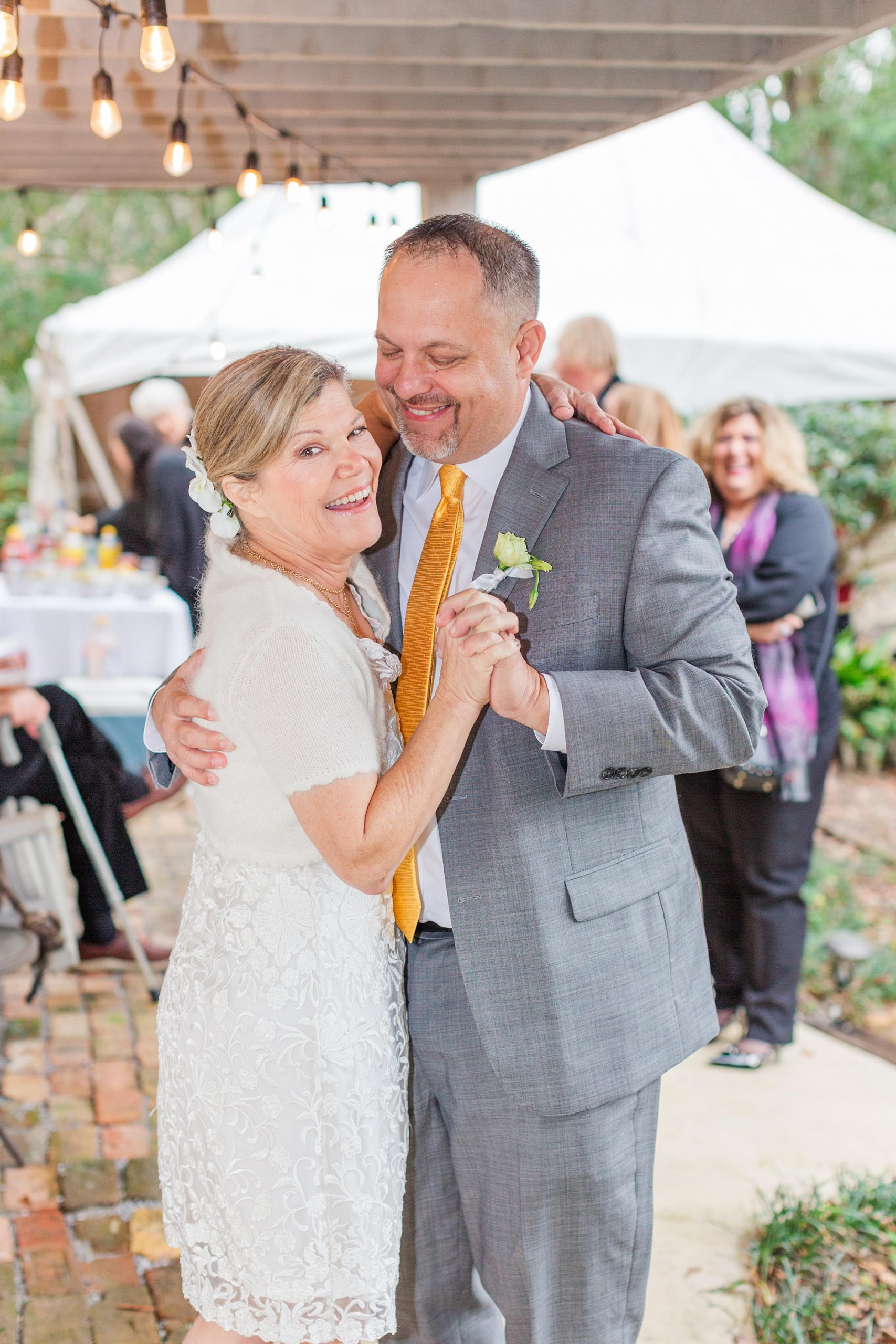 bride and groom dance together during Spring Hill backyard wedding reception