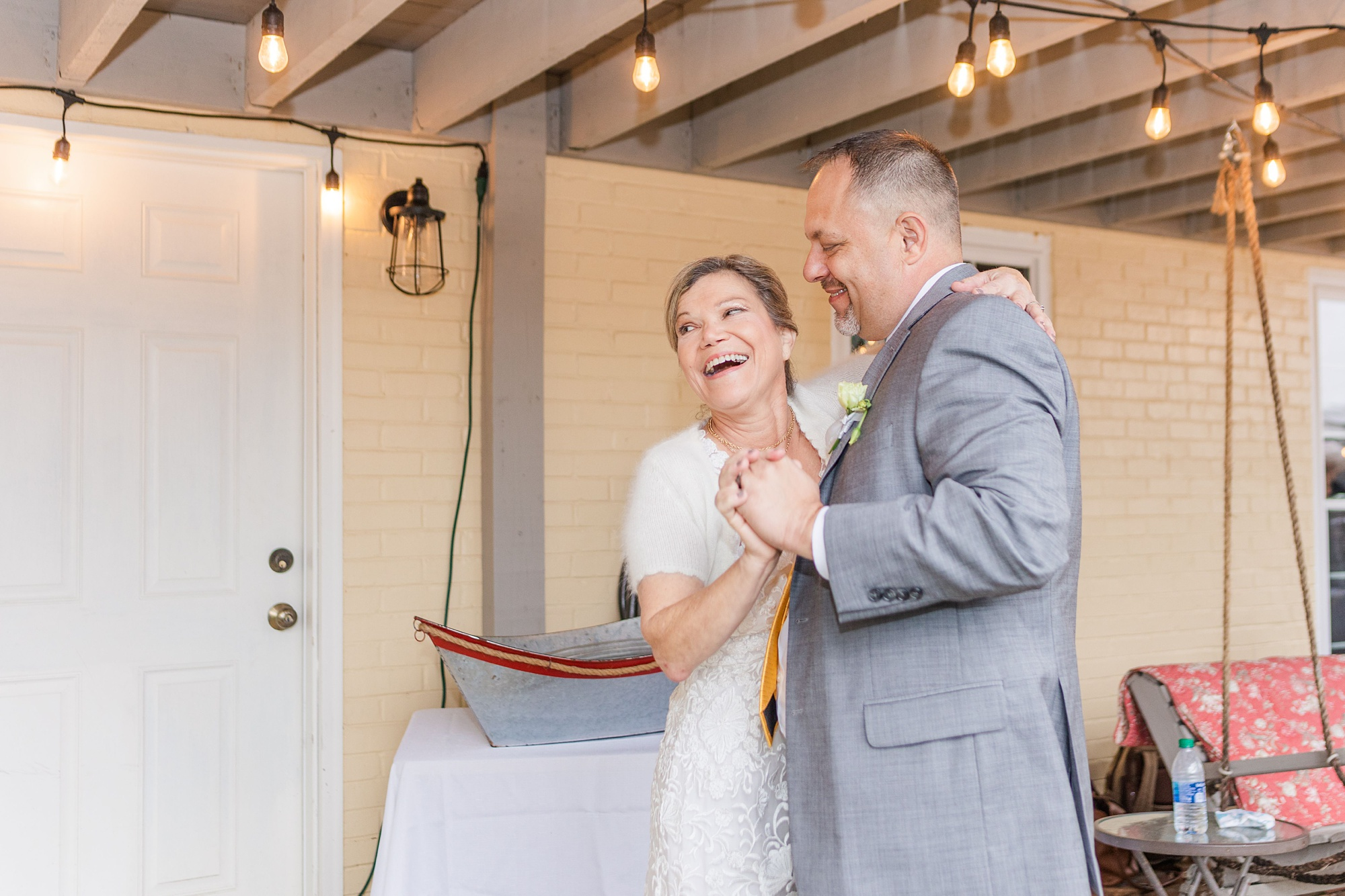 bride laughs during dance at Spring Hill backyard wedding reception