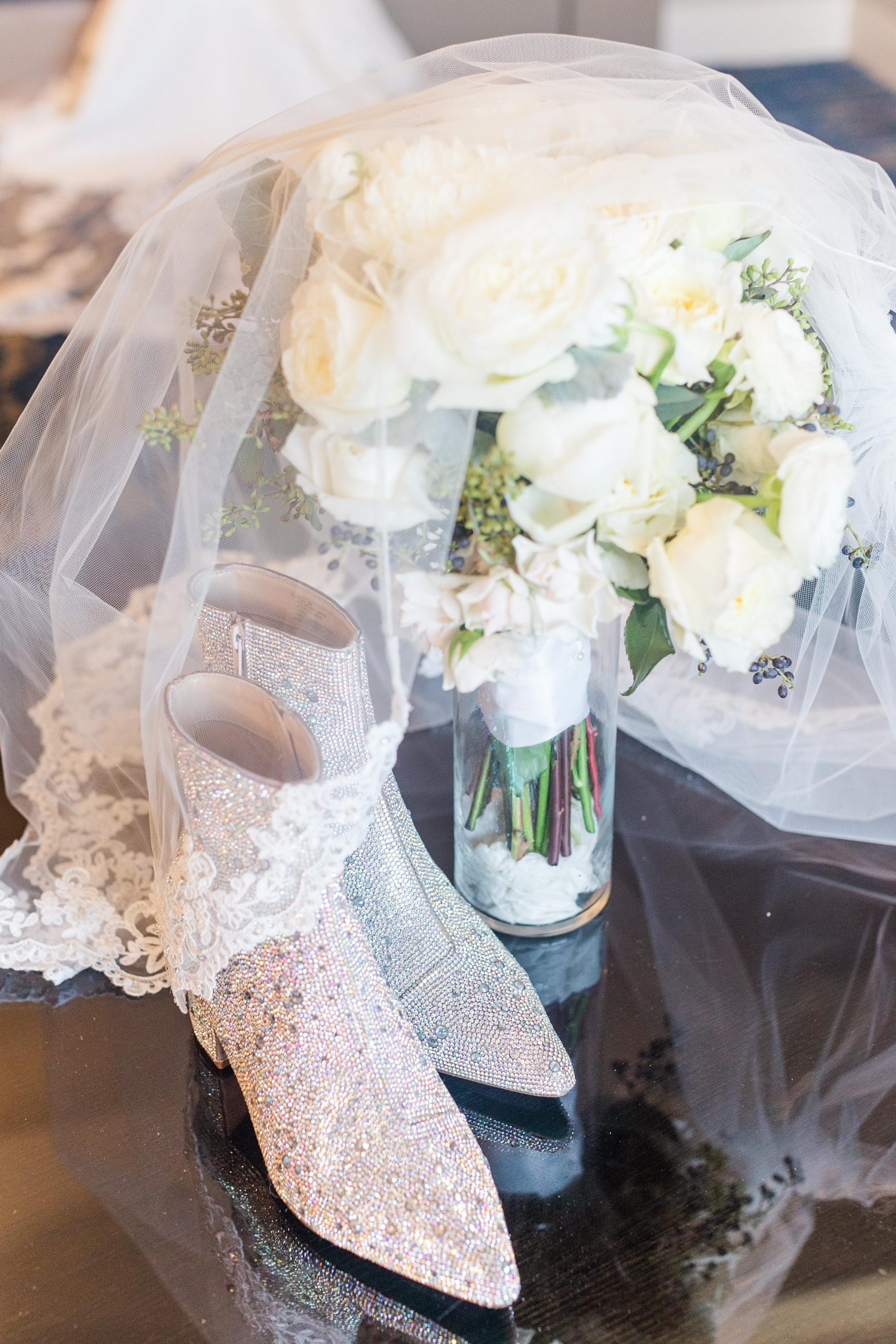 bride's sparkly boots for winter wedding