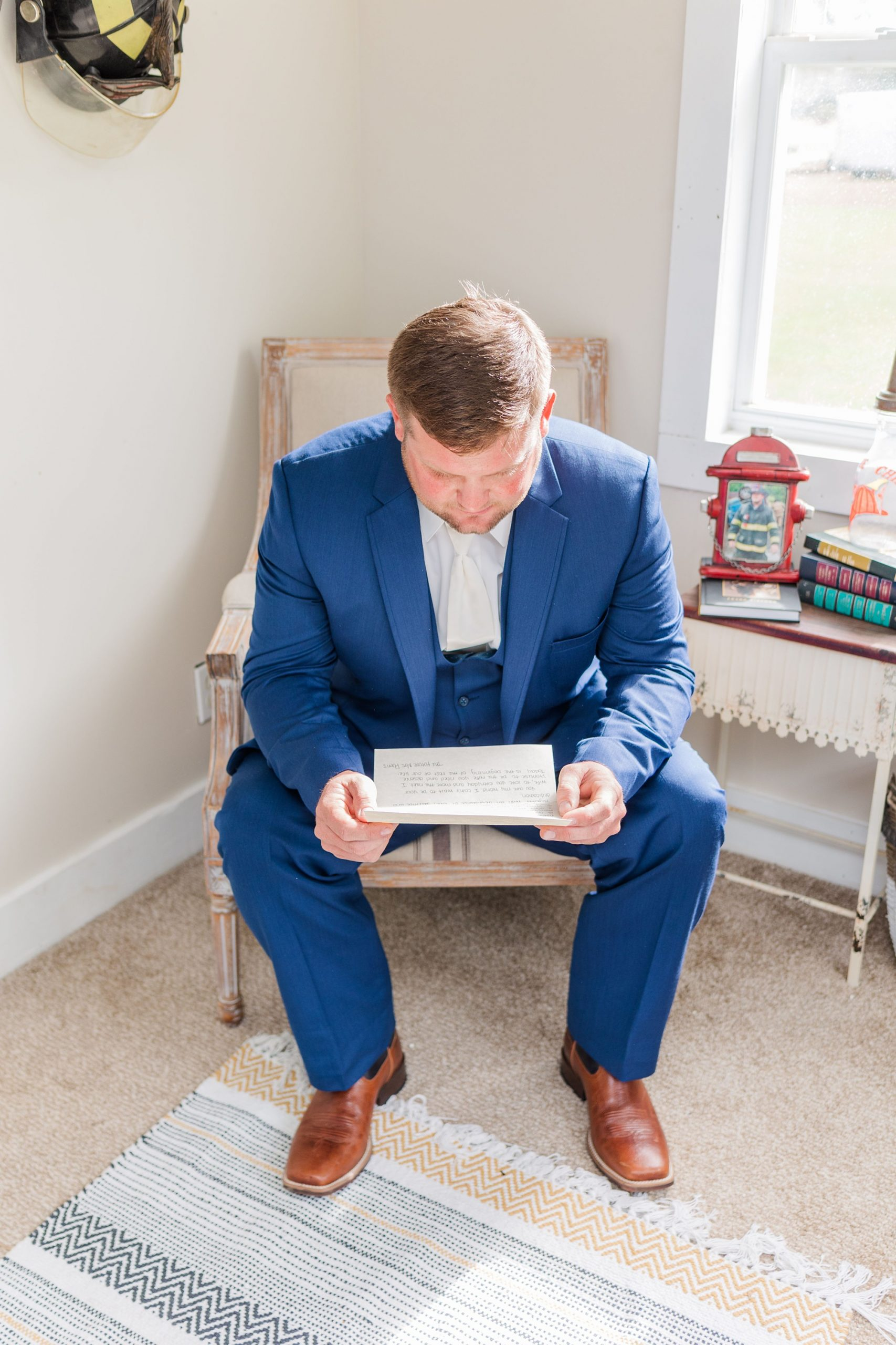 groom reads letter while preparing for New Year's Eve wedding